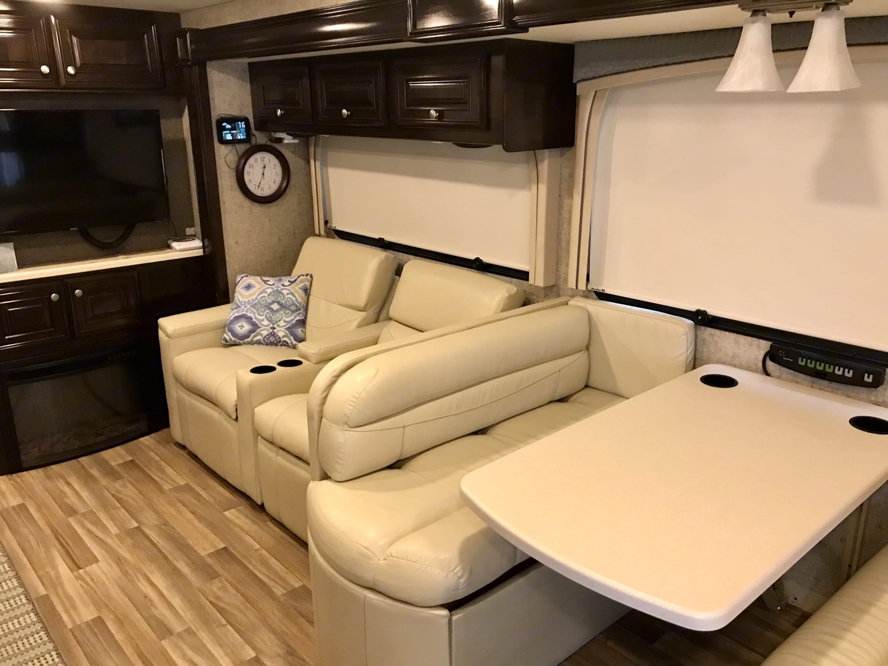 This is the dinette and theatre seats. The chairs recline next to the fireplace and pull-out TV. . Thor Motor Coach Miramar 2017