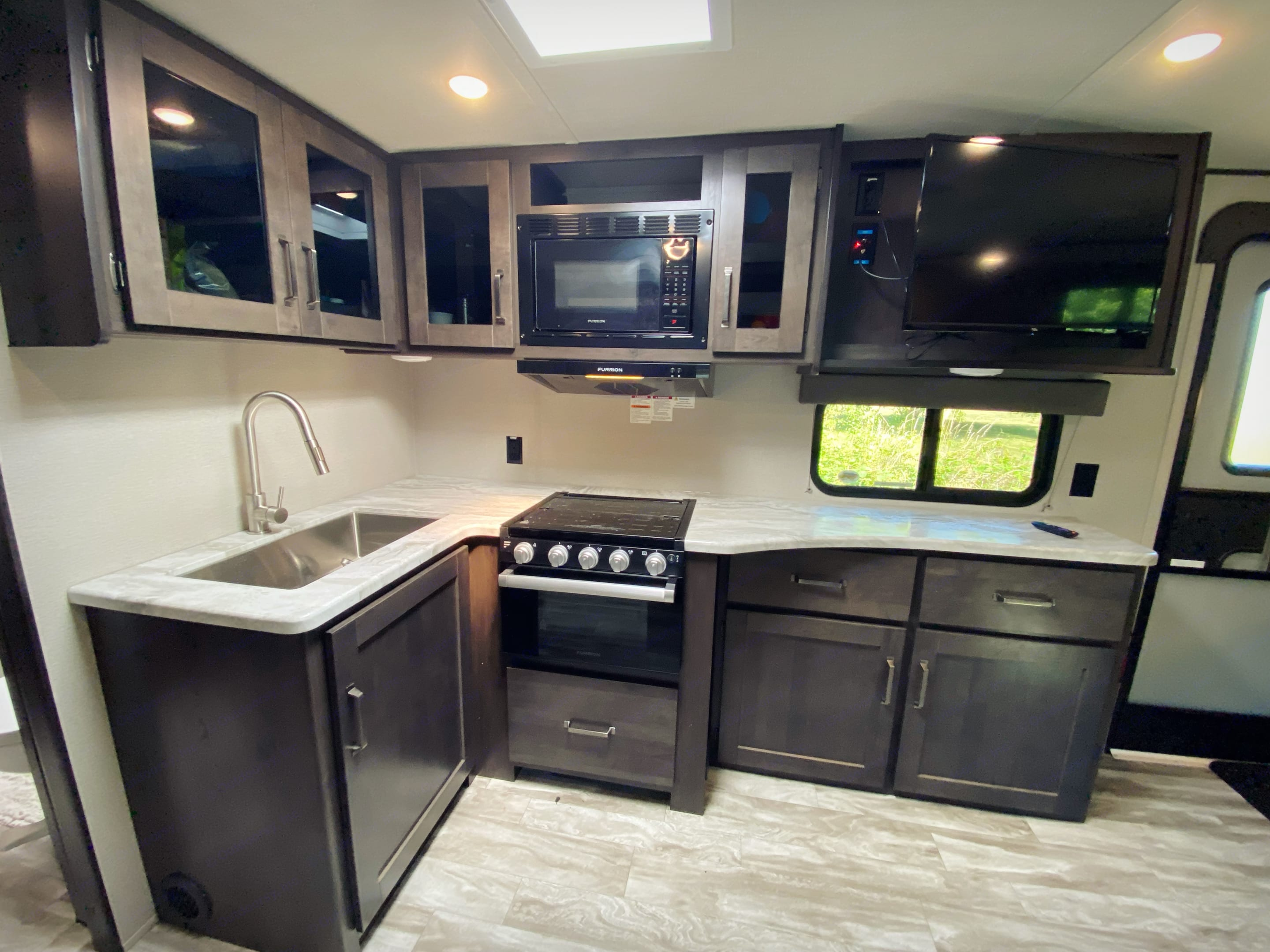 Kitchen sink and counter/cabinet  area. Grand Design Other 2021