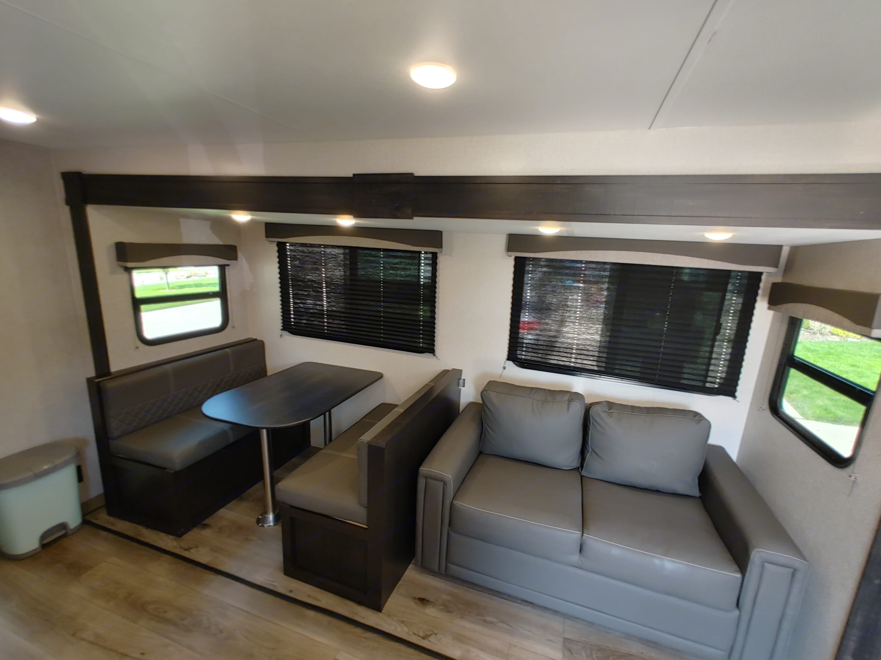 Dinette & Trifold Sofa fold down into sleeping areas. Starcraft Travel Trailer 2021