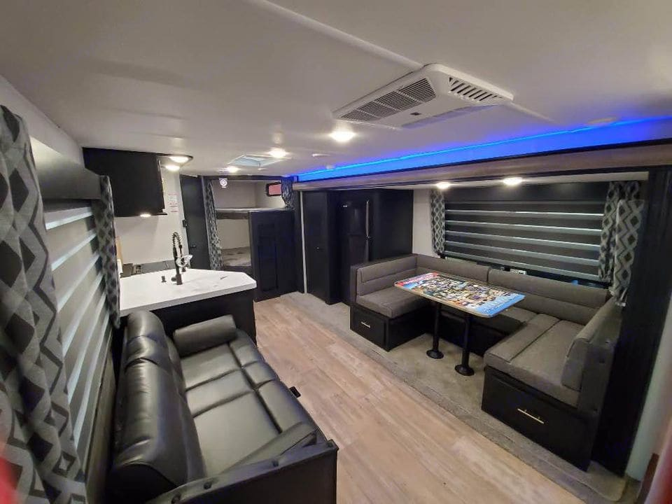 Pantry and full size fridge on the slideout side of the RV. Dinette and sofa convert to comfortable sleeping spaces.. Forest River Cherokee 2021