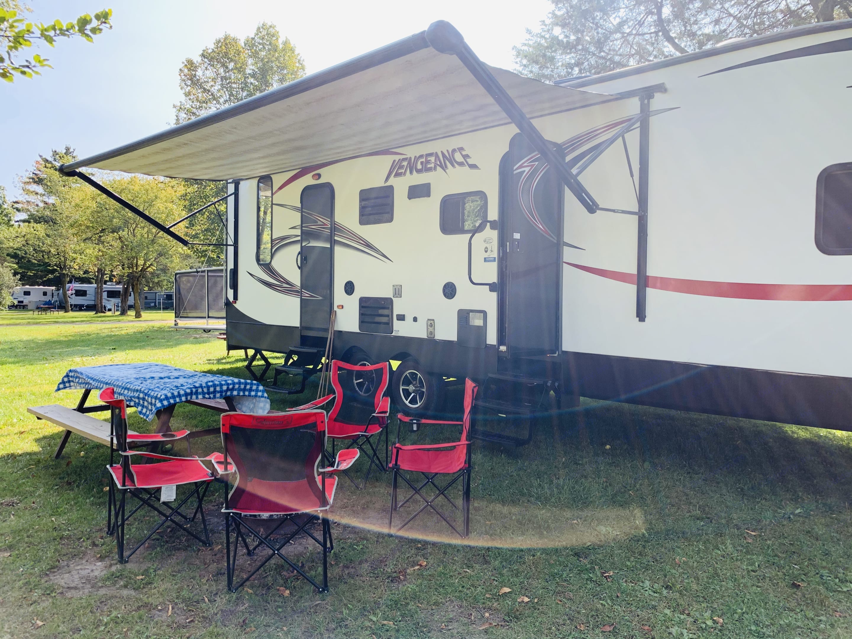 Relax under the awning, which has lights for the evening time.. Forest River Vengeance 2015