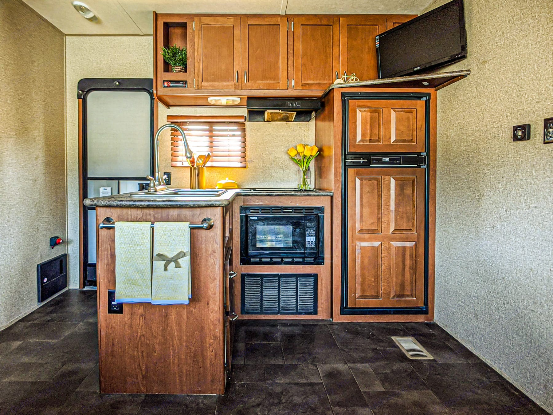 This is the main door on the left side of the picture, and here is a picture of the kitchen.. Forest River Vengeance 2015