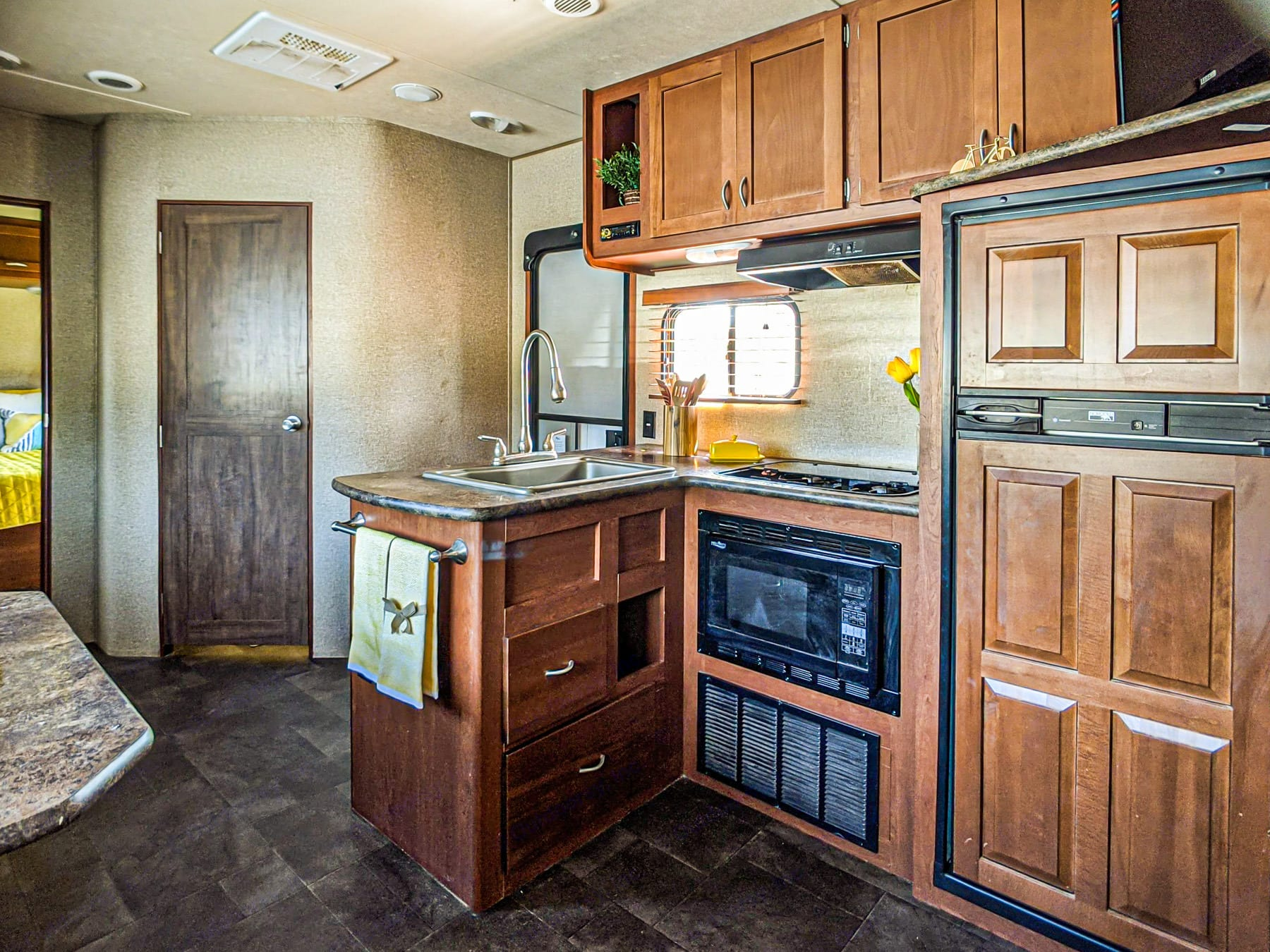 Another picture of the kitchen and the door in the corner leads to the bathroom.. Forest River Vengeance 2015