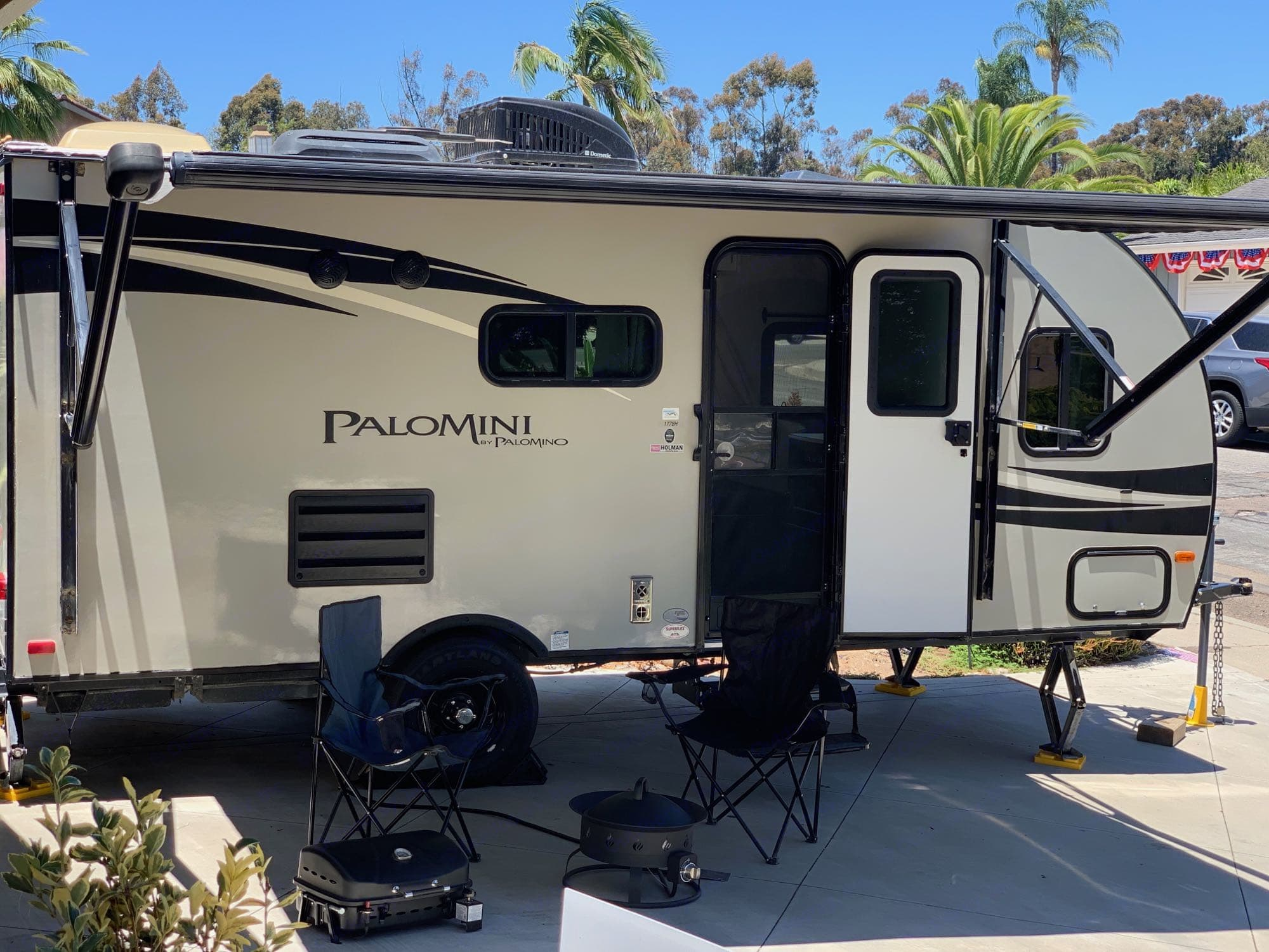 Camping grill, gas fire ring, chairs (3 adult size, 1 child size included), and the spacious, LED-lit awning.. Palomino Palomini 2016