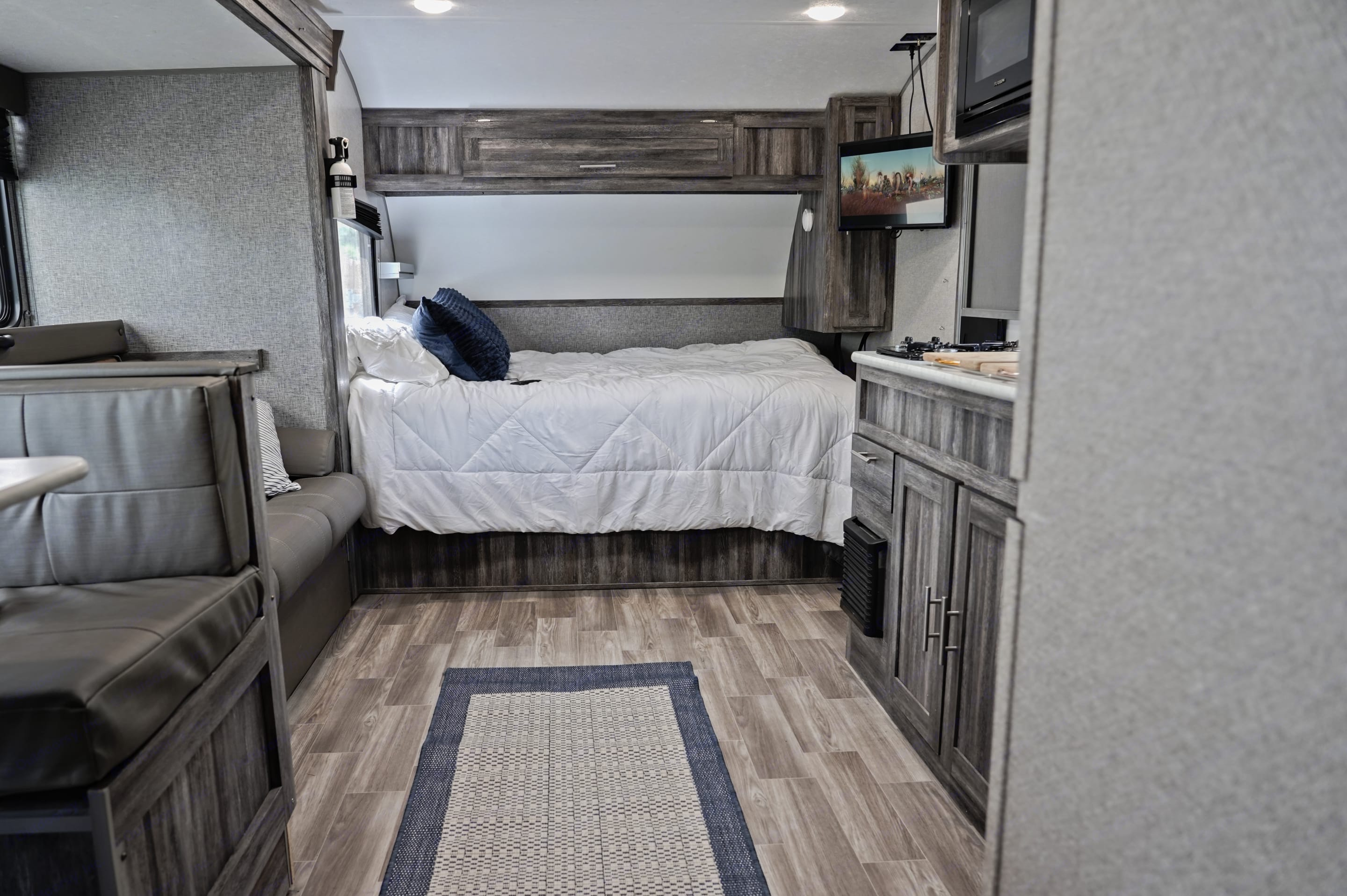 Cosy queen with television at the foot of the bed.. Forest River Wildwood 2020