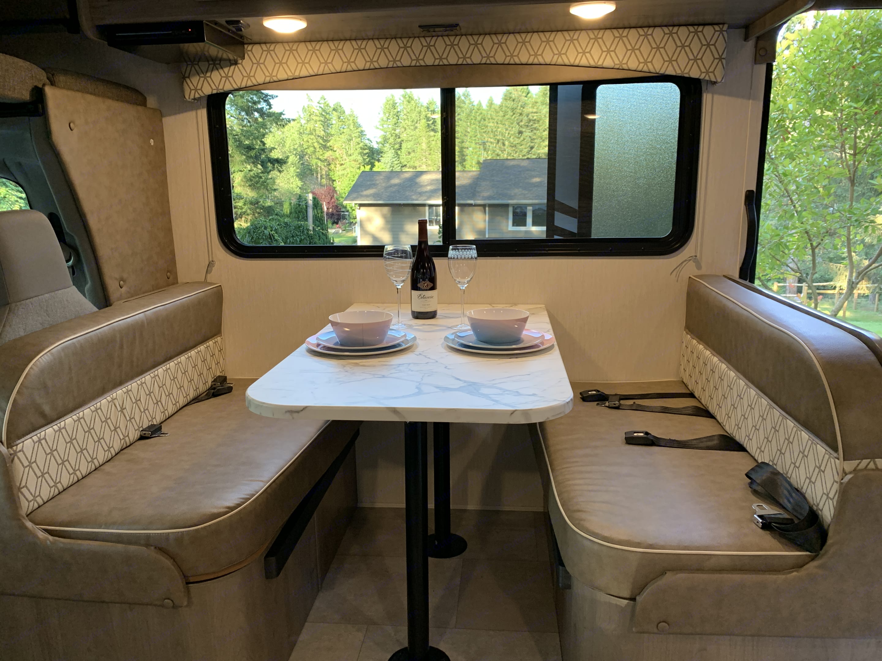 We love sitting around the dinner table and discussing all of our adventures! When in motion this is a great place to buckle up and play travel games.. Coachmen Freelander 2021