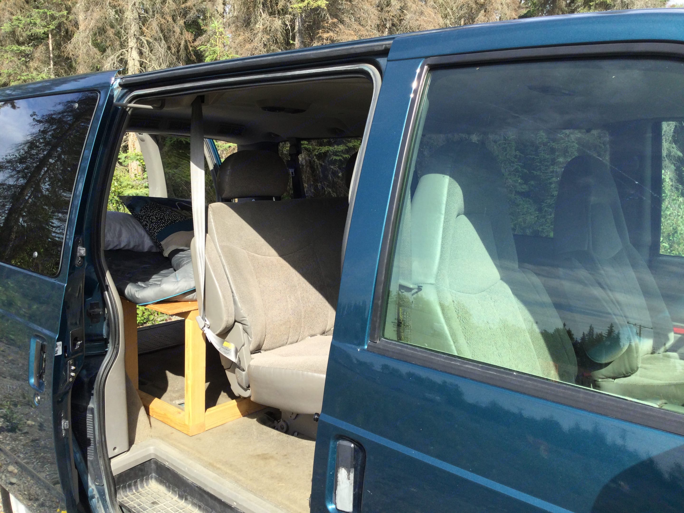 This back seat folds flat to make a queen sized bed. Chevrolet Astro 2003