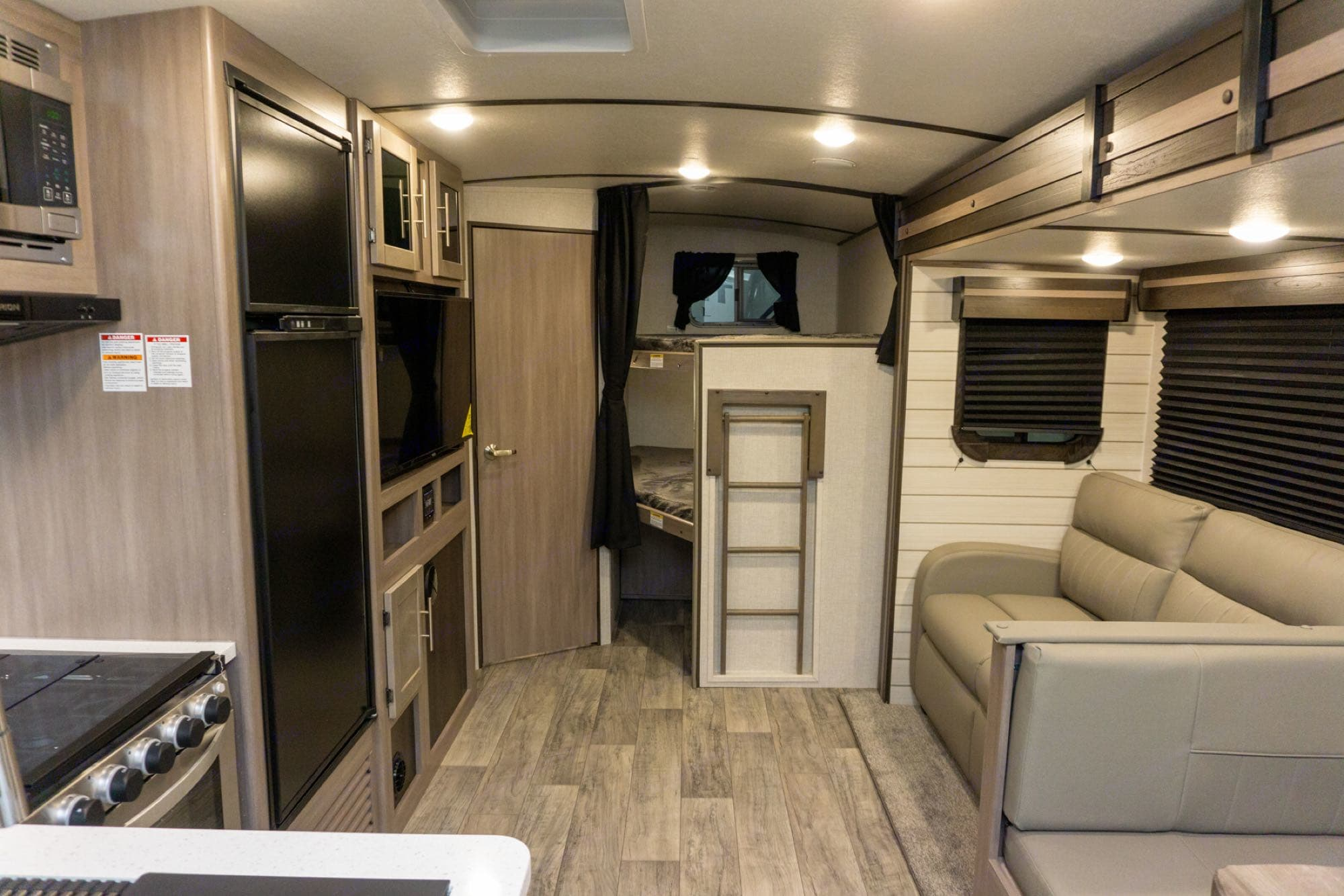 Rear full sized bunks and comfy couch that fold out for additional sleeping space.. Crossroads Other 2021