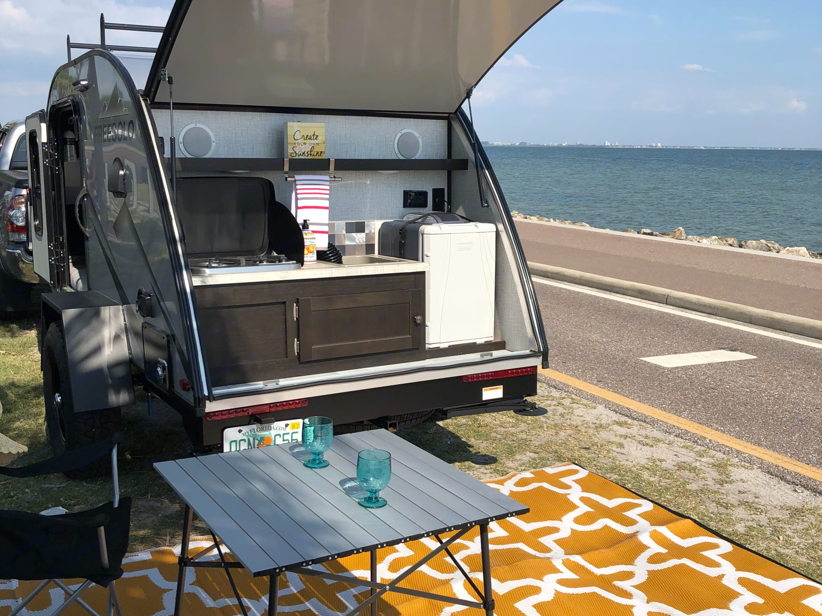 The teardrop has a fantastic outdoor kitchen! Pictured and included in the rental are 2 camping chairs, a collapsible table for 2 and an outdoor rug.. Other Other 2021