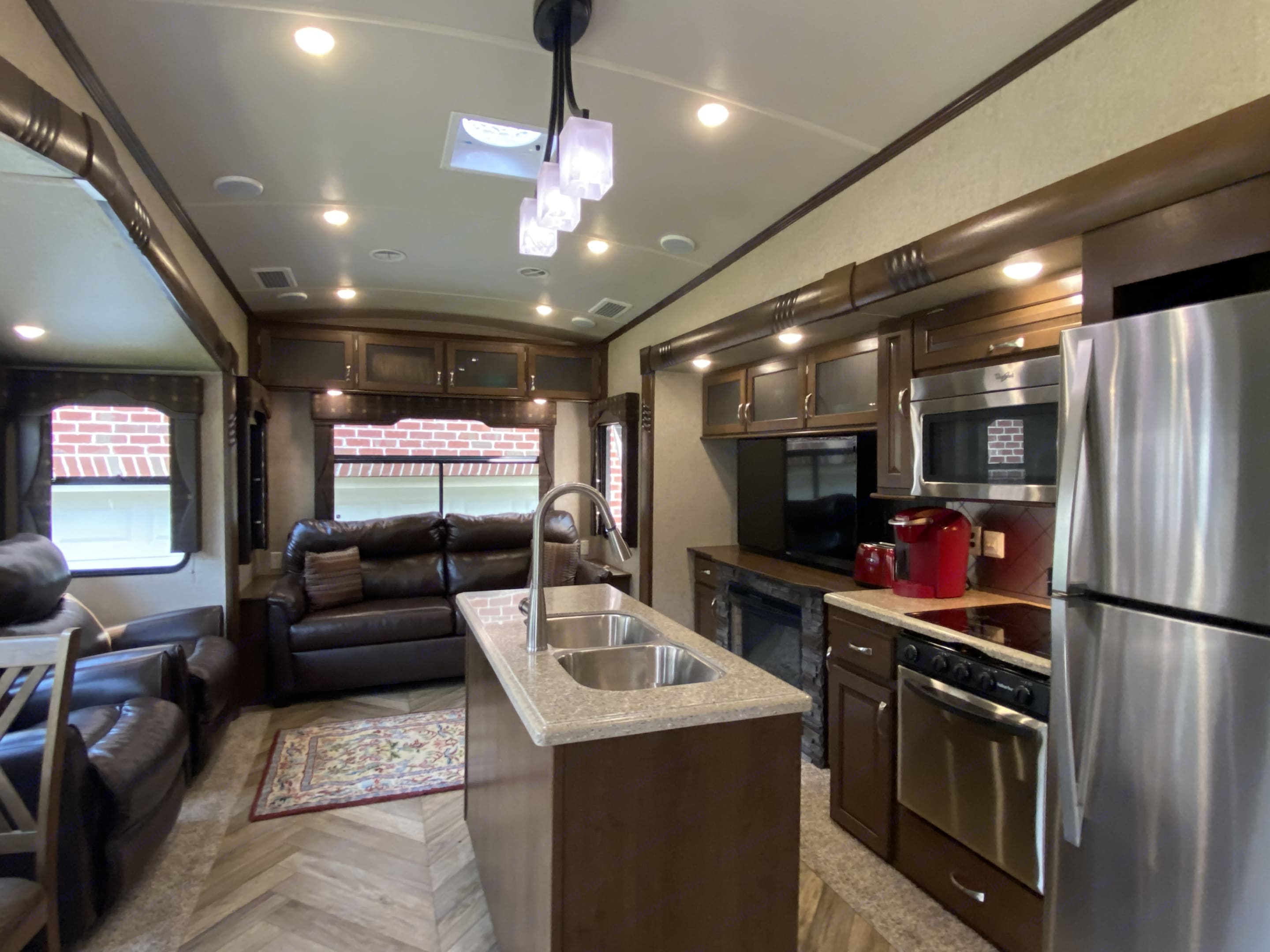 Spacious living / dining / kitchen area. . Forest River Cedar Creek Fifth Wheel 2016