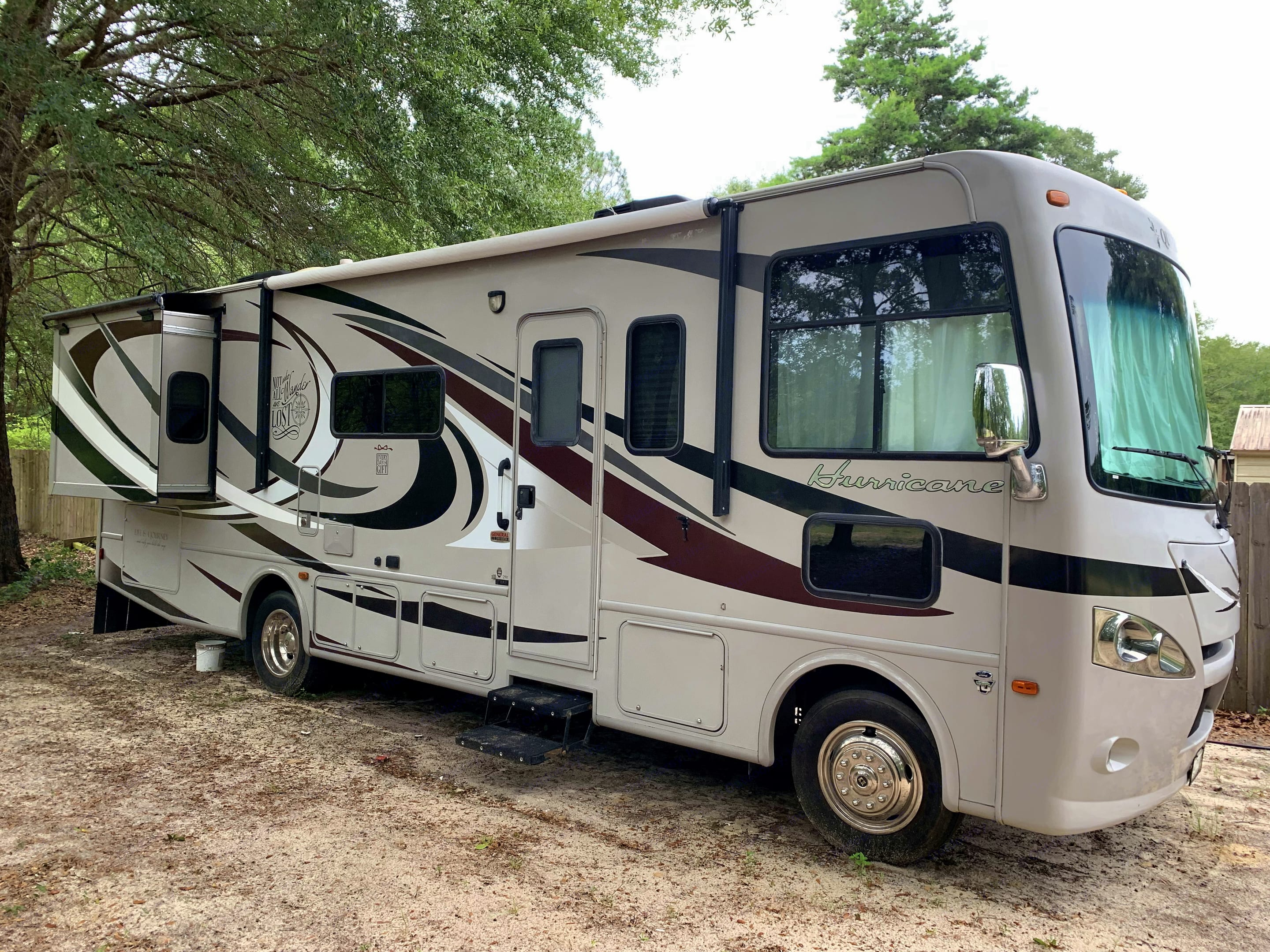 Stowage spaces (front to back) include twin chassis batteries, road hazard safety equipment, slide-out dining table.. Thor Motor Coach Hurricane 2013