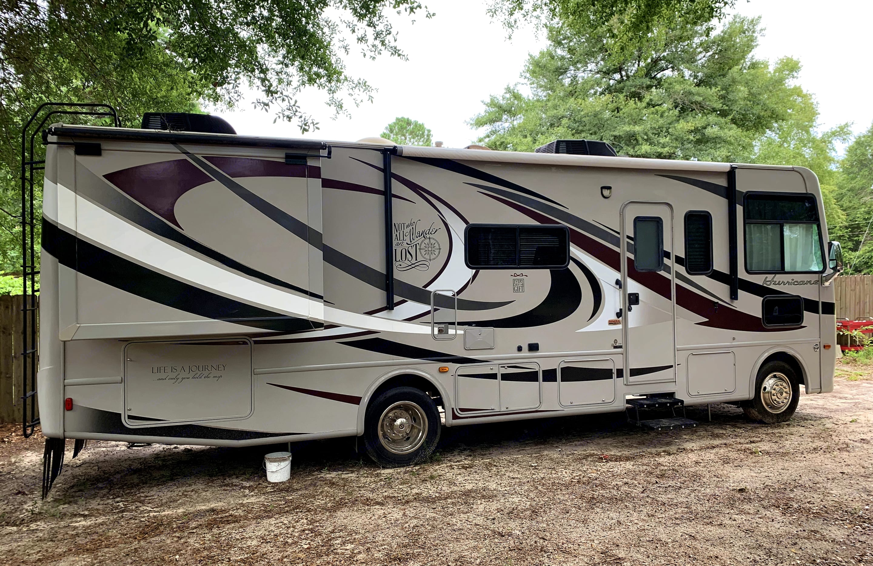 Stowage in this large compartment at rear is for tools, lounge chairs, grill, safety equipment.  Electronic awning w/tie downs.. Thor Motor Coach Hurricane 2013