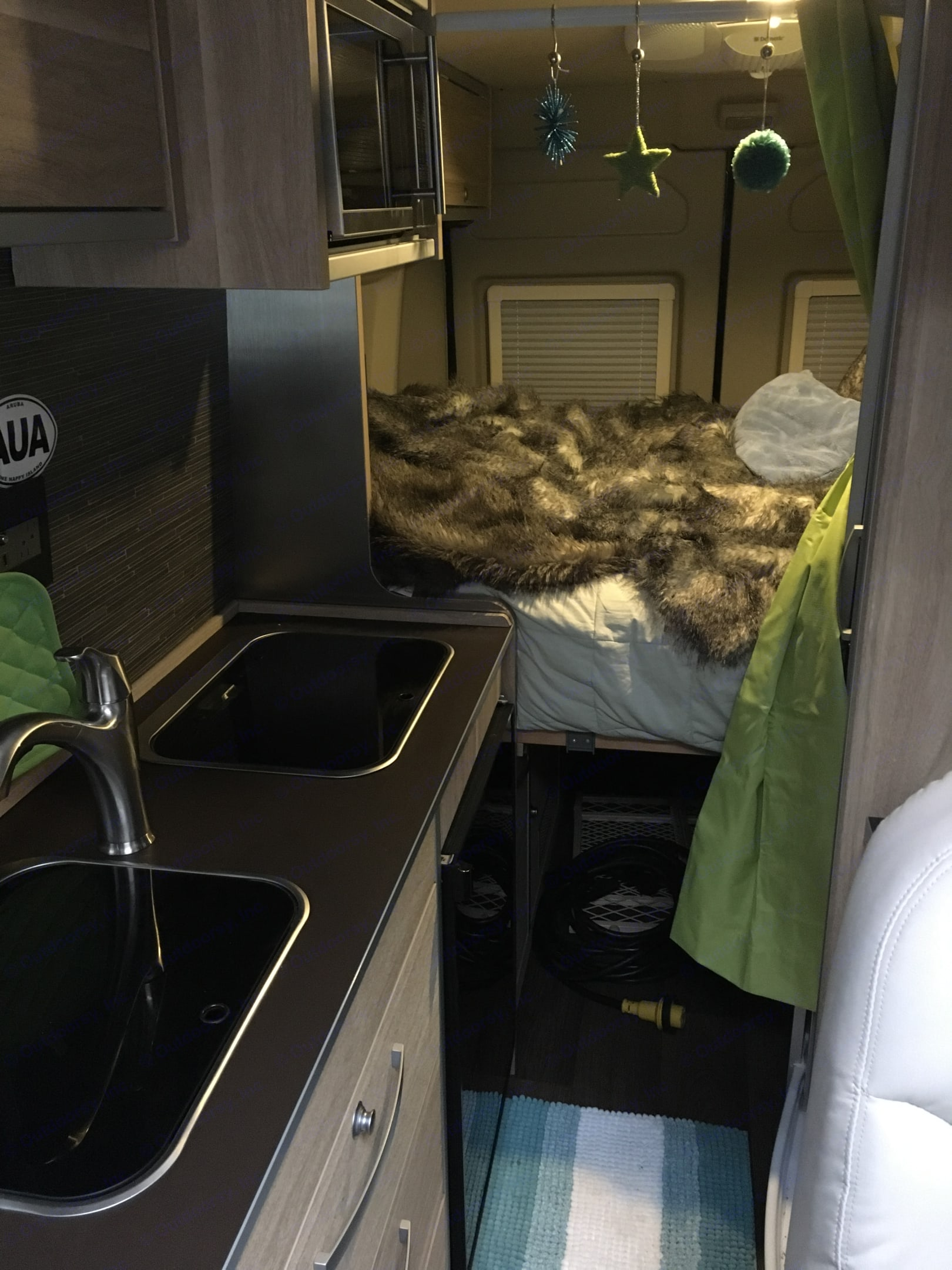 Fully equipped kitchen with 2 burner propane stove, refrigerator with small freezer, microwave and sink. Murphy bed can be raised. Hymer Other 2017