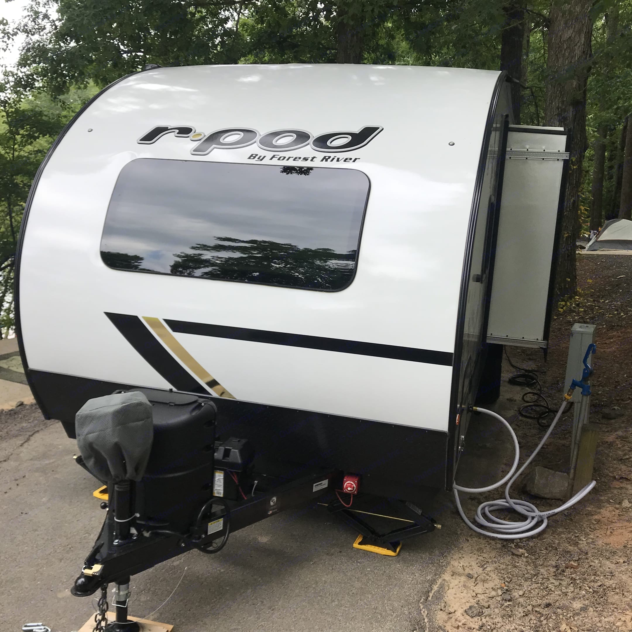 Exterior front. Shown at Campground with Slide-Out extended and Water Hooked-up. Forest River R-Pod 2021