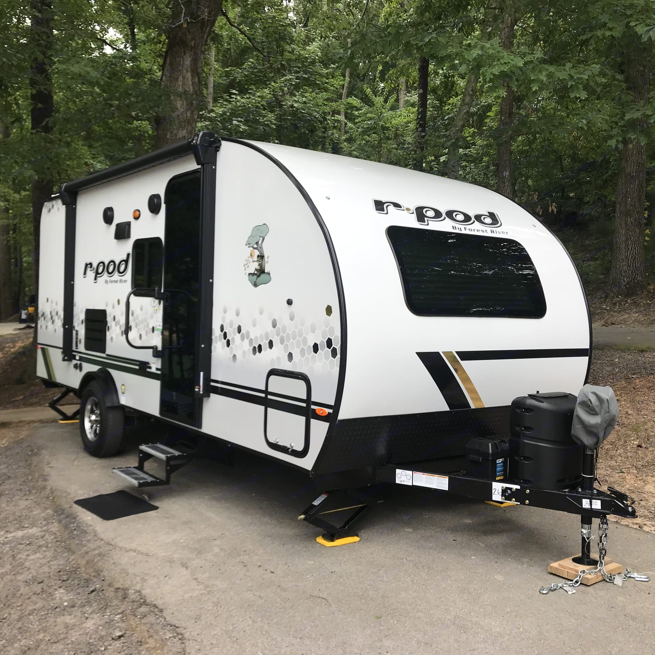 Awning is in. Has 4 Stabilizer Jacks on each corner, to keep the trailer from rocking when inside. . Forest River R-Pod 2021