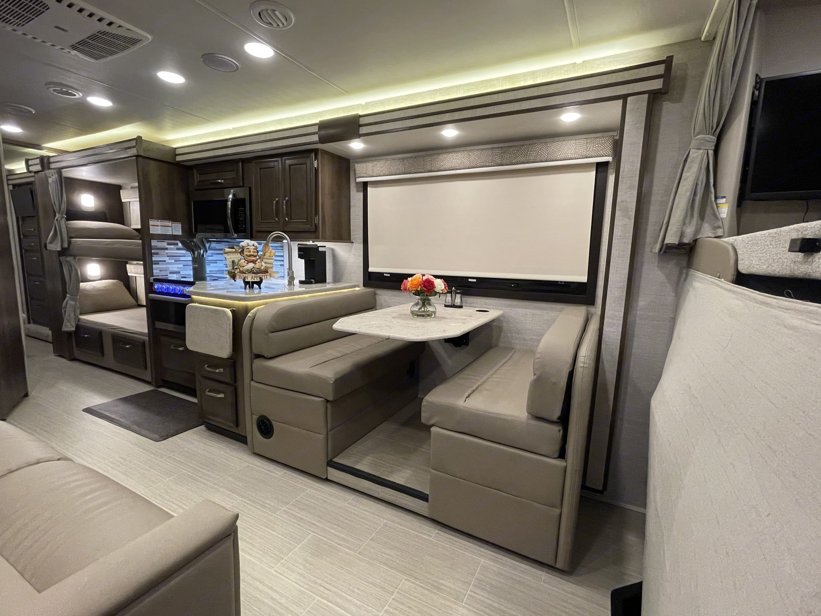 Dinette with 4 seat belts, kitchen and fold-out couch. . Entegra Coach Other 2021