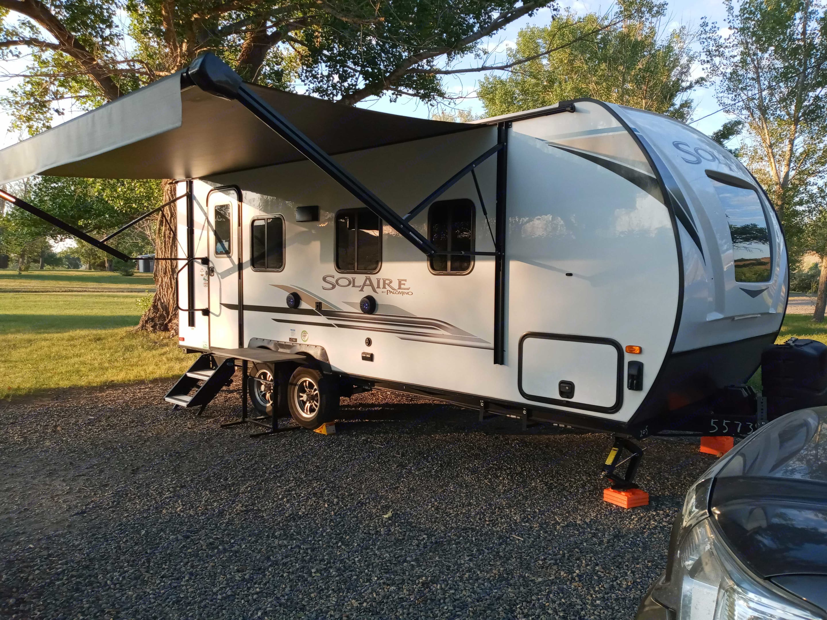 Nice big Awning that provides nice cover. Forest River Palomino Solaire 205ss 2021