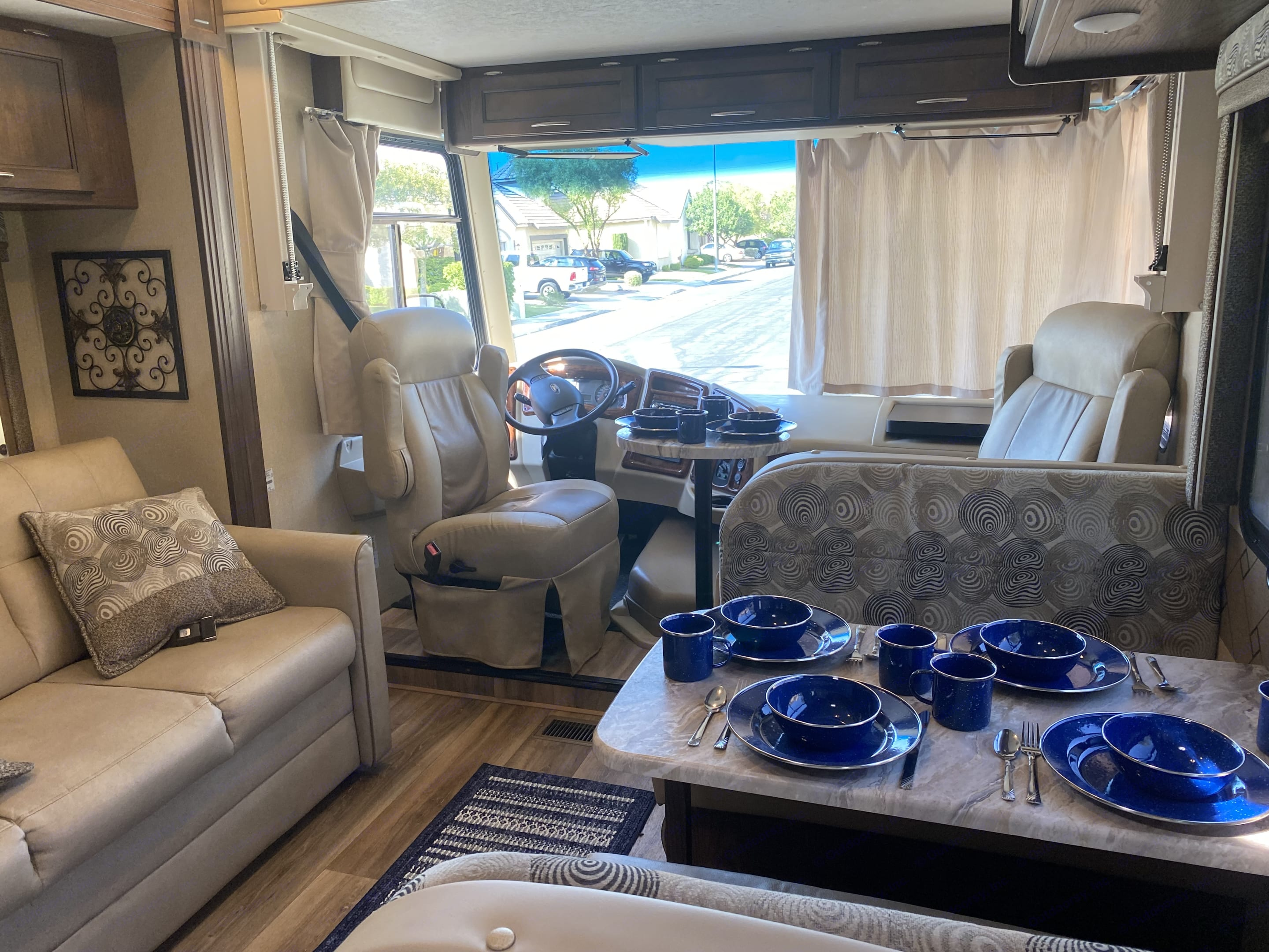 Main living area has a large slide out providing plenty of room.  The captain's chairs swivel and provide extra seating.  . Coachmen Pursuit 2019