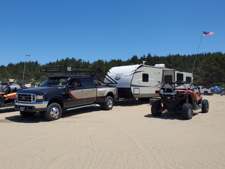 The Happy Glamper loves camping on the sand!. Open Range Light 2016