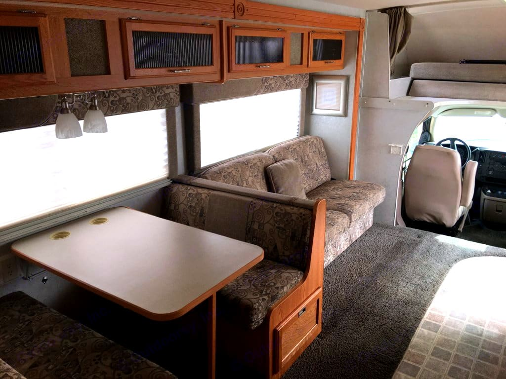SO fun - these two areas can be modified into beds! You can fit 2 smaller people in each, so truly 8 people could stay for so little per night.. Winnebago Outlook 2006