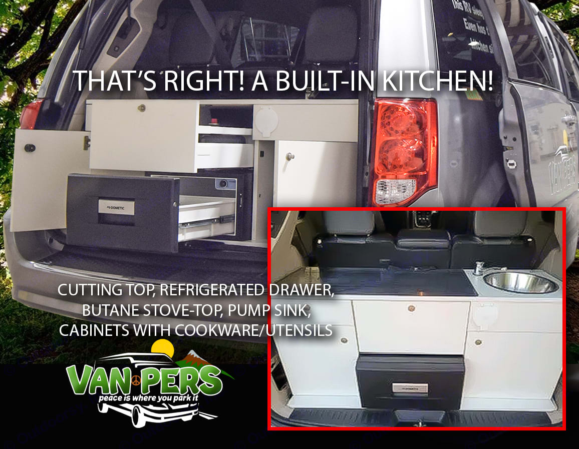 A built in kitchen? Yes!! Cutting top, refrigerated drawer, butane stove-top, pump sink, cookware/utensils, etc.. Dodge Caravan 2018