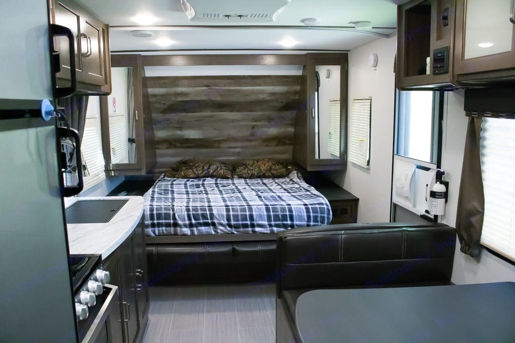 This is a queen sized bed that folds down. There is a curtain that can be pulled across for additional privacy. . Keystone Passport 2019