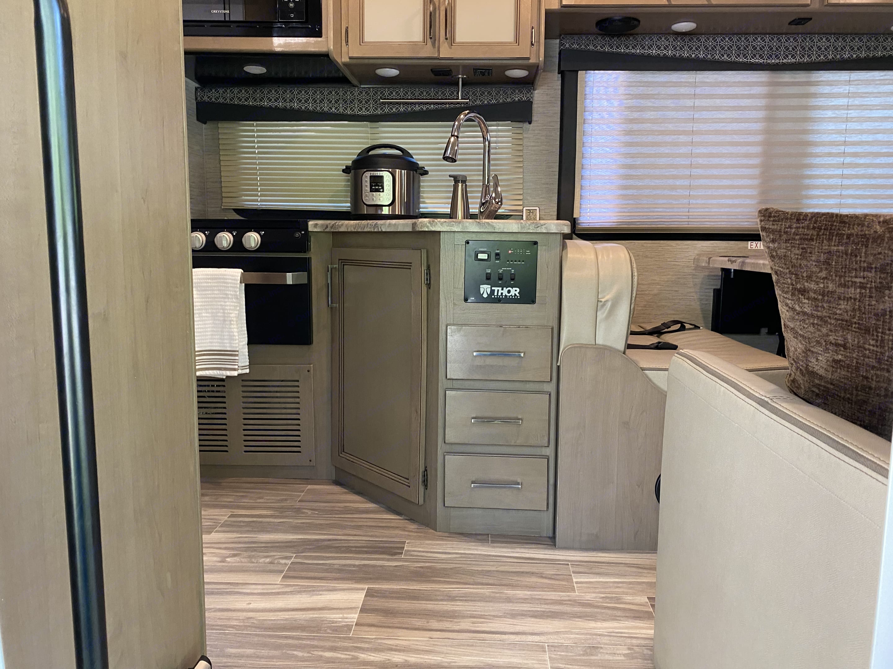 Propane stovetop, instant pot and sink, all help with cooking for any meals. . Thor Motor Coach Four Winds 2021