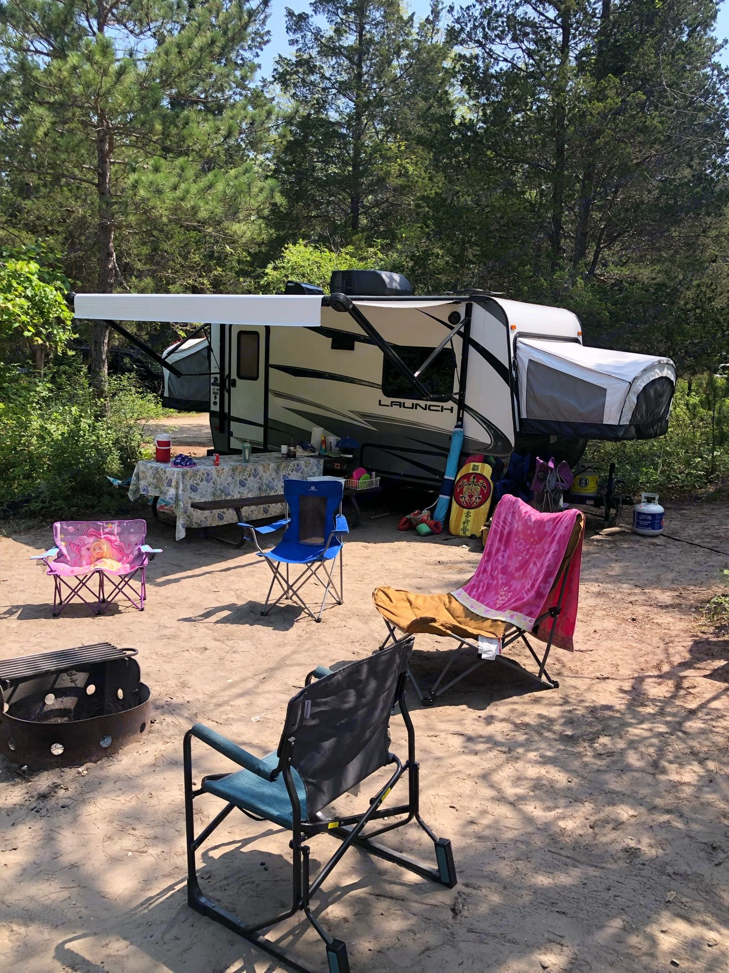 This shot was taken after a week of camping. Notice the extension of the awning relative to the picnic table below it.. Starcraft Launch 2018