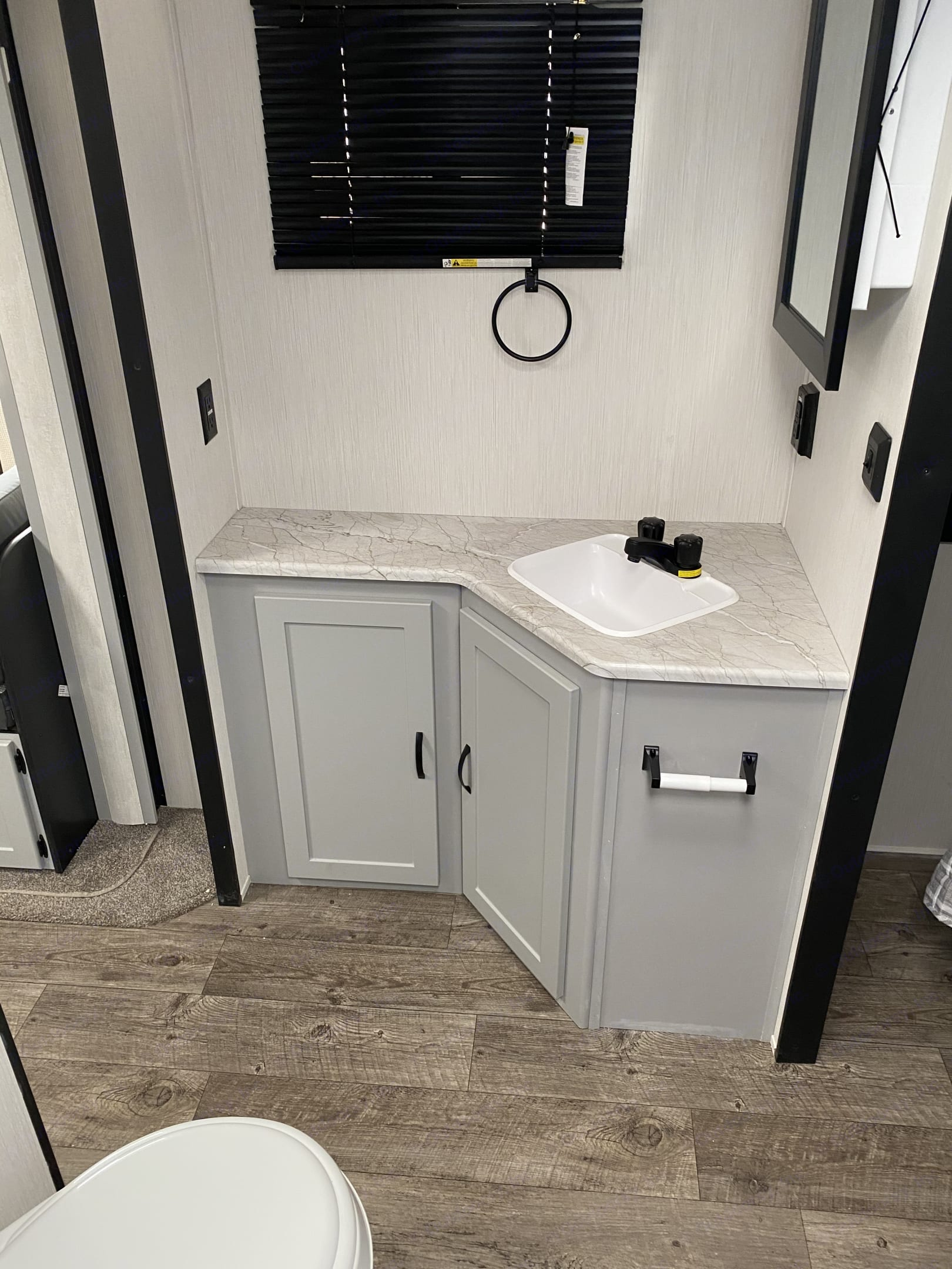 Plenty of counter space in the bathroom. . Forest River Vibe 2021
