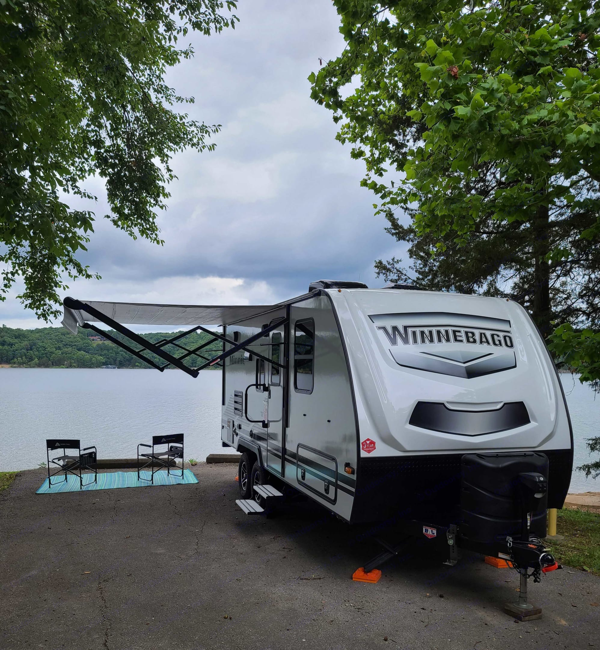 Exterior front and 12' awning fully extended . Winnebago Micro Minnie 2021
