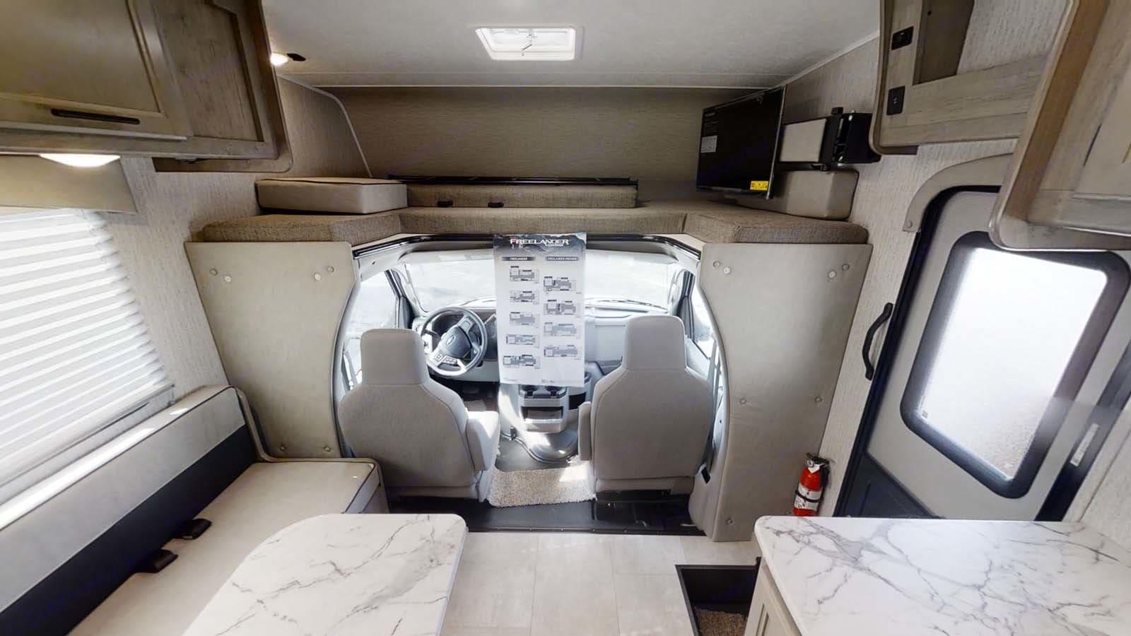 Interior towards driver and passenger seats. Coachmen Freelander 2021