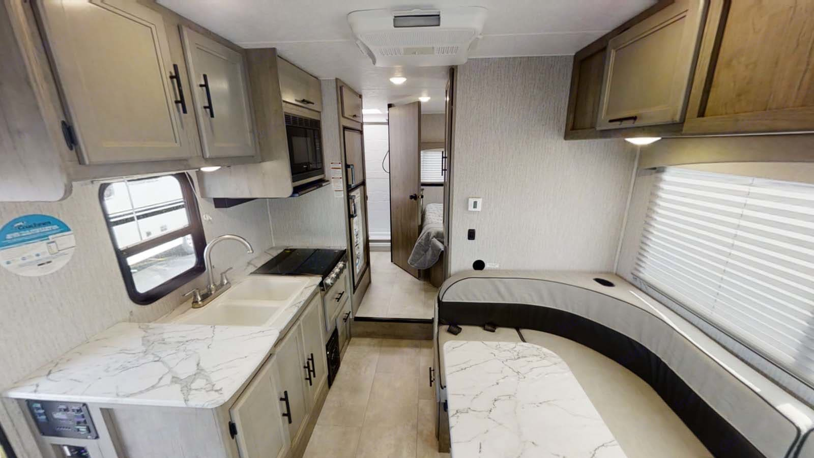 dining area with kitchen. Coachmen Freelander 2021