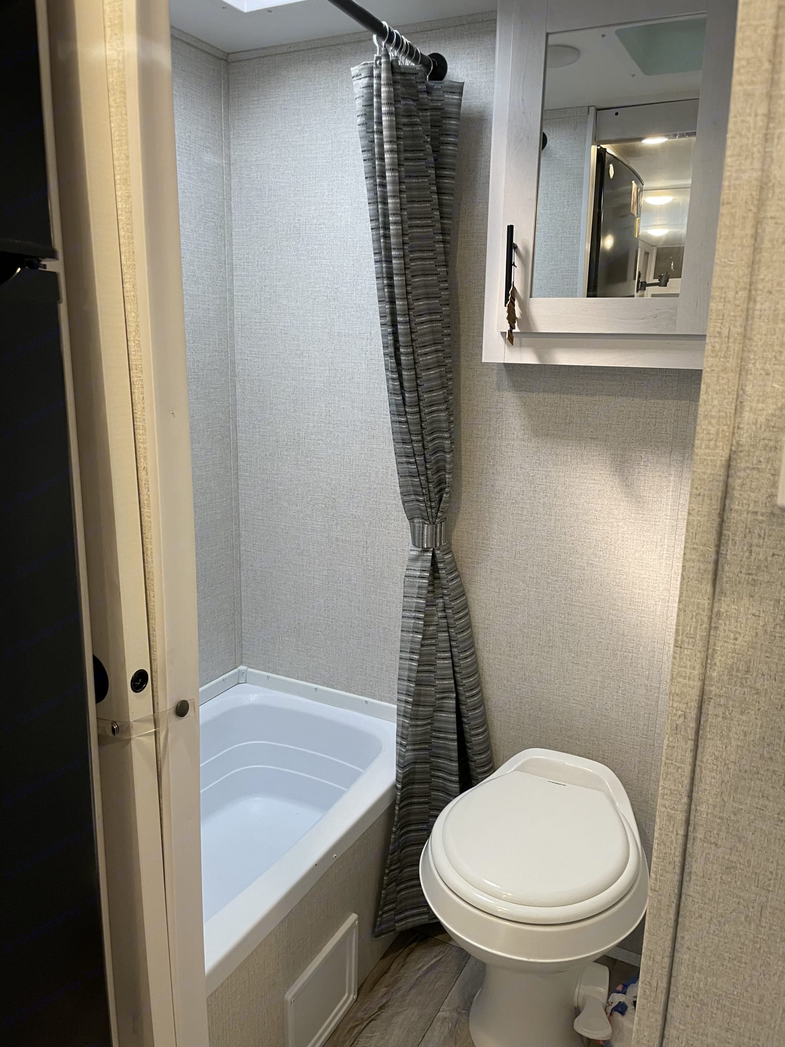 Separate shower/bath and toilet.  Sliding door for privacy.. Coleman Other 2021