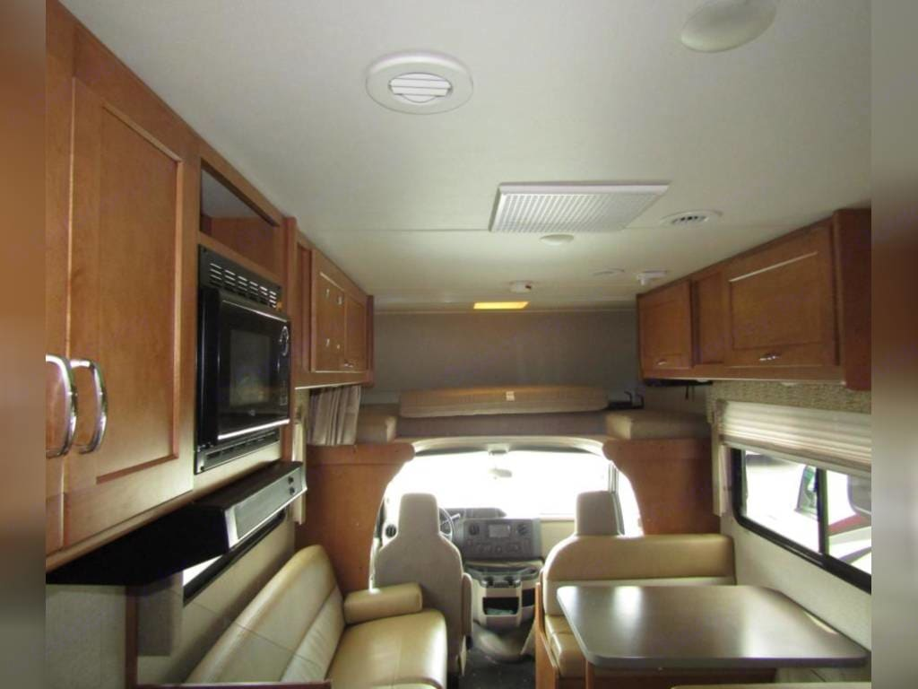 View from the master bed. Folding couch and convertable dinette.. Winnebago Minnie Winnie 2016