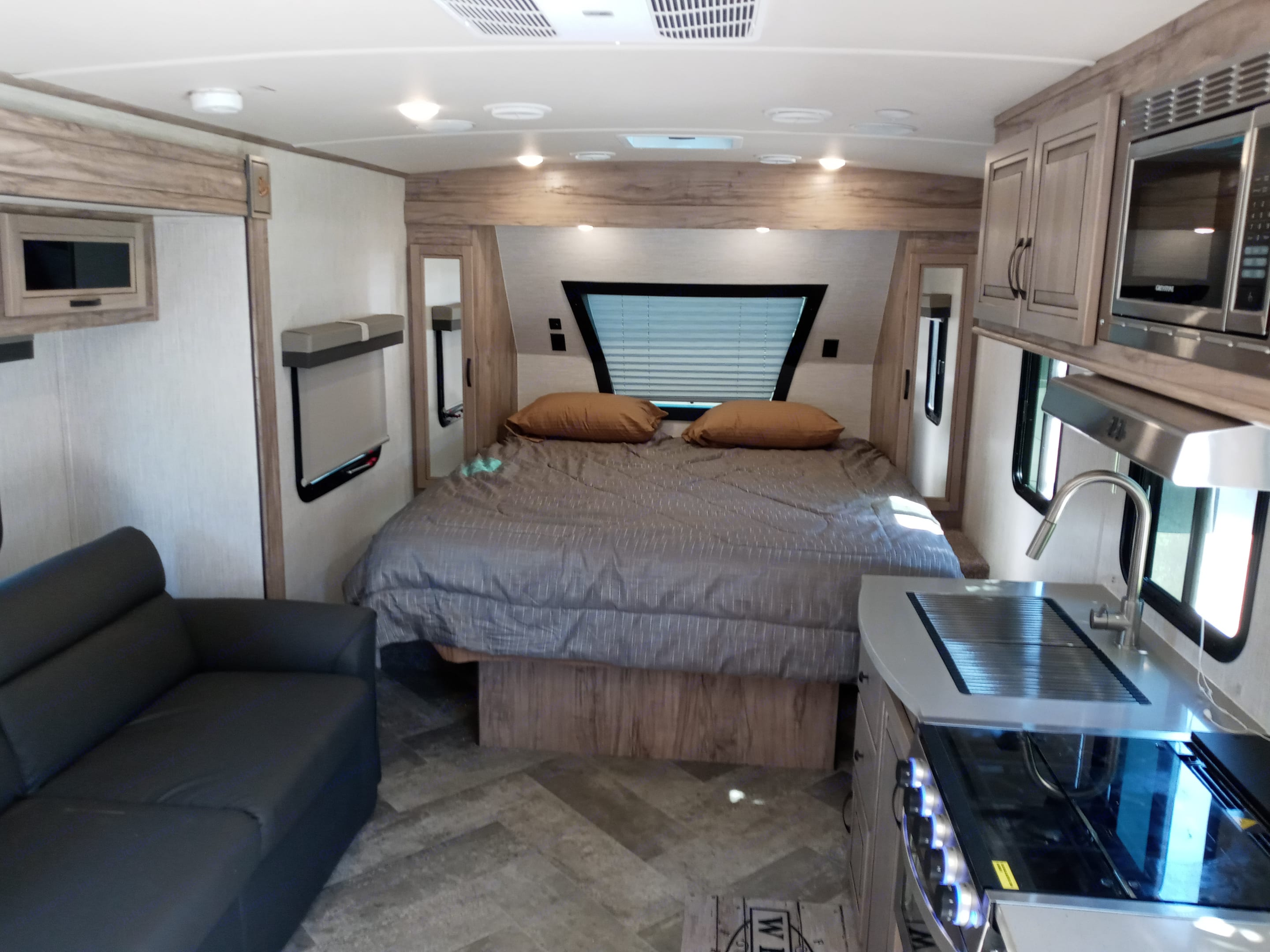 This is an RV King bed that is 70 inches wide. Plenty of room and walk around, no climbing over your partner to get out of bed. . Forest River Palomino Solaire 205ss 2021