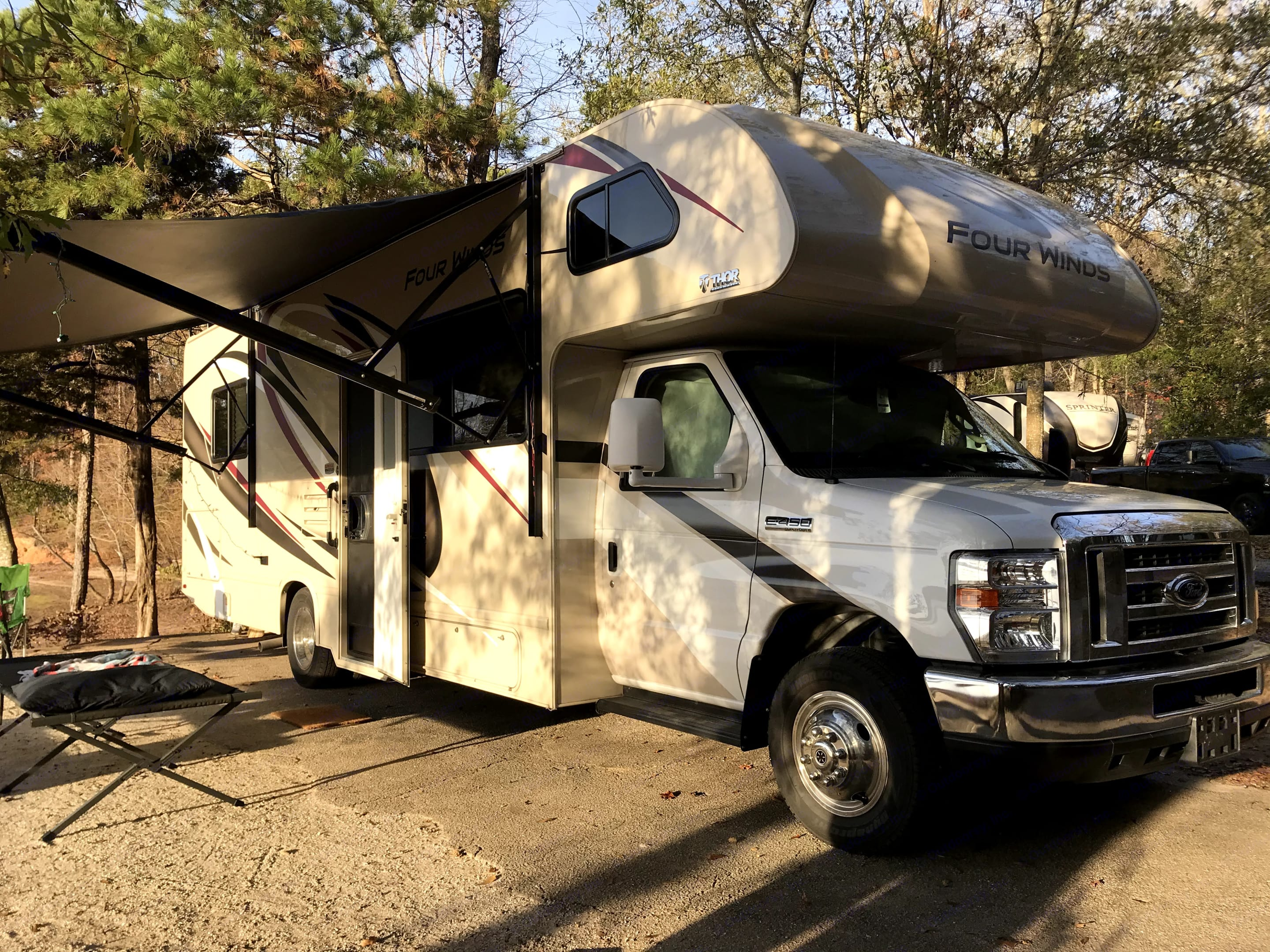 Camp side awning with LED strip lights for night time activities.. Thor Motor Coach Four Winds 2020