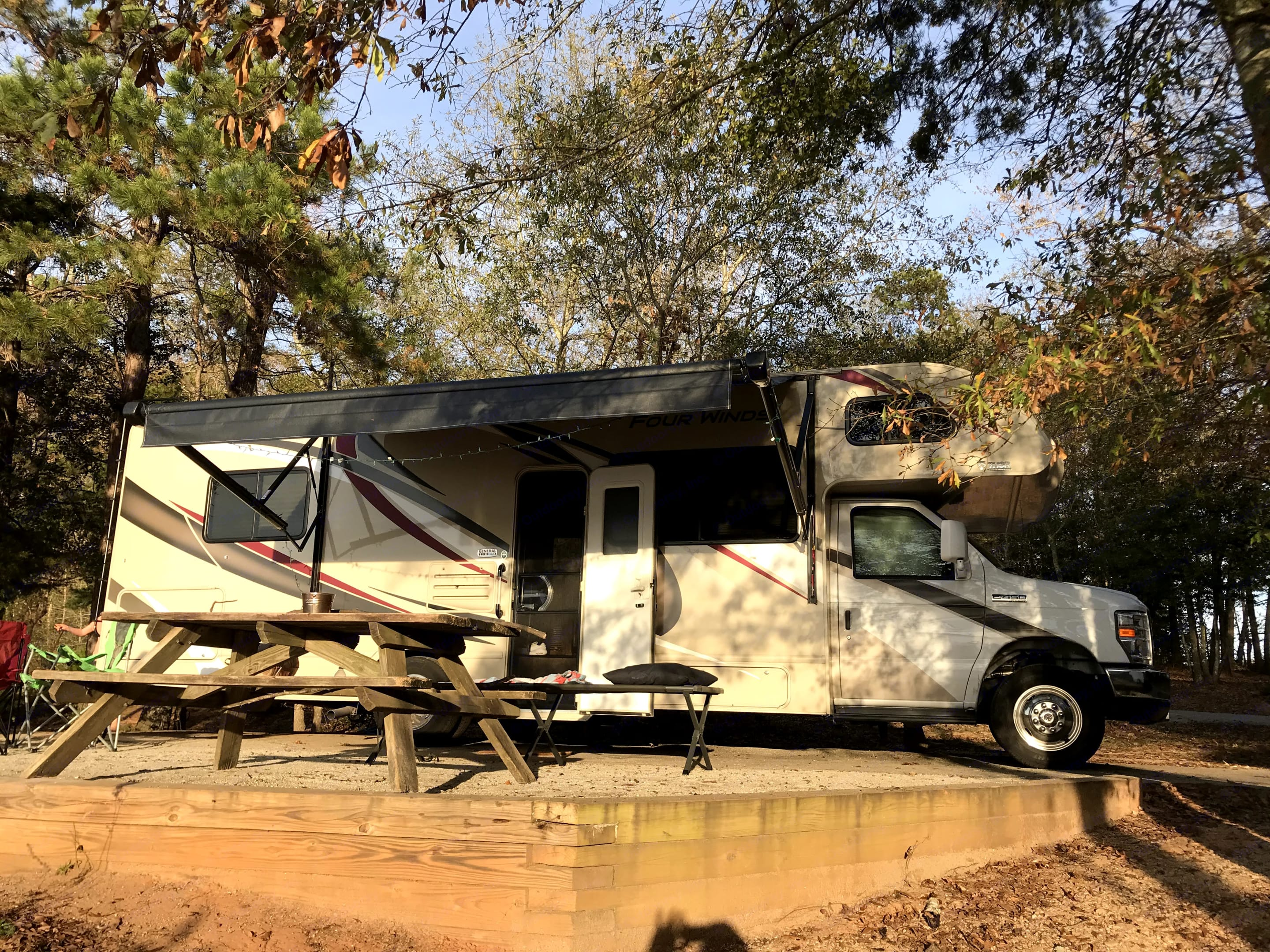 Power awning keeps sun and rain off.  Lots of outside storage in rear 'basement.'. Thor Motor Coach Four Winds 2020