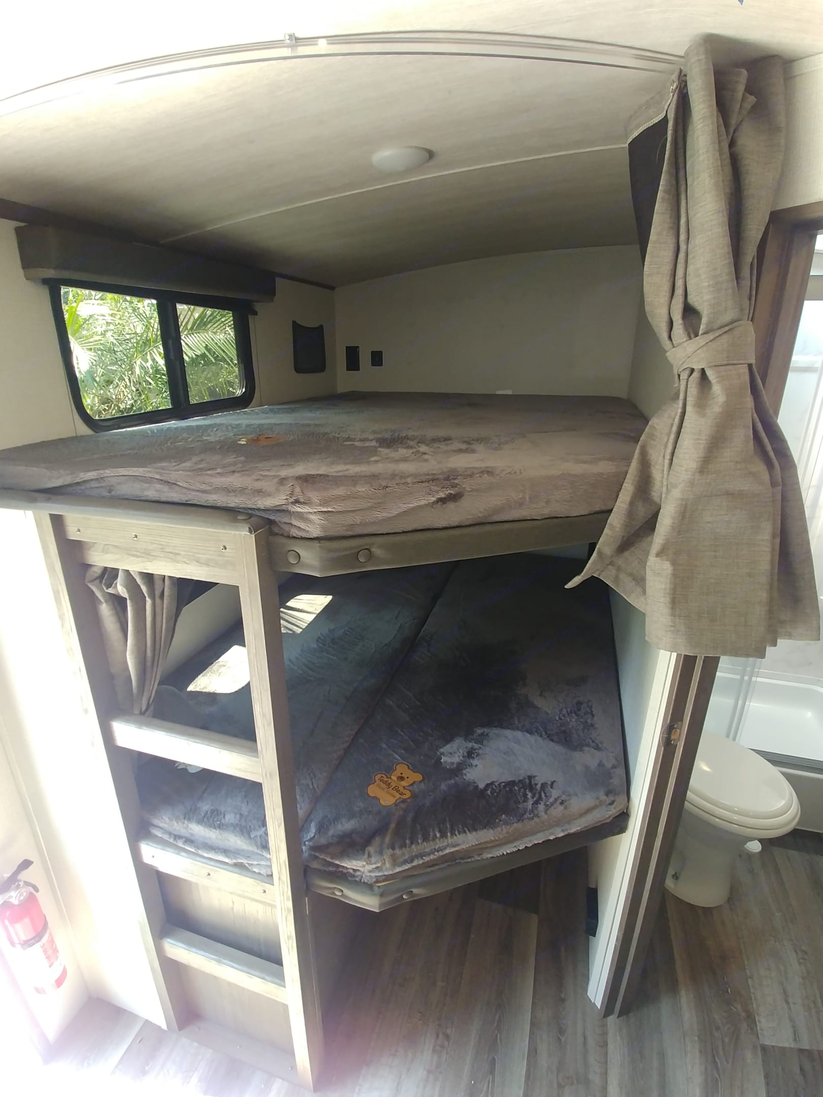 Rear double wide bunk beds large enough for two children each. . Keystone Cougar Half-Ton 2021
