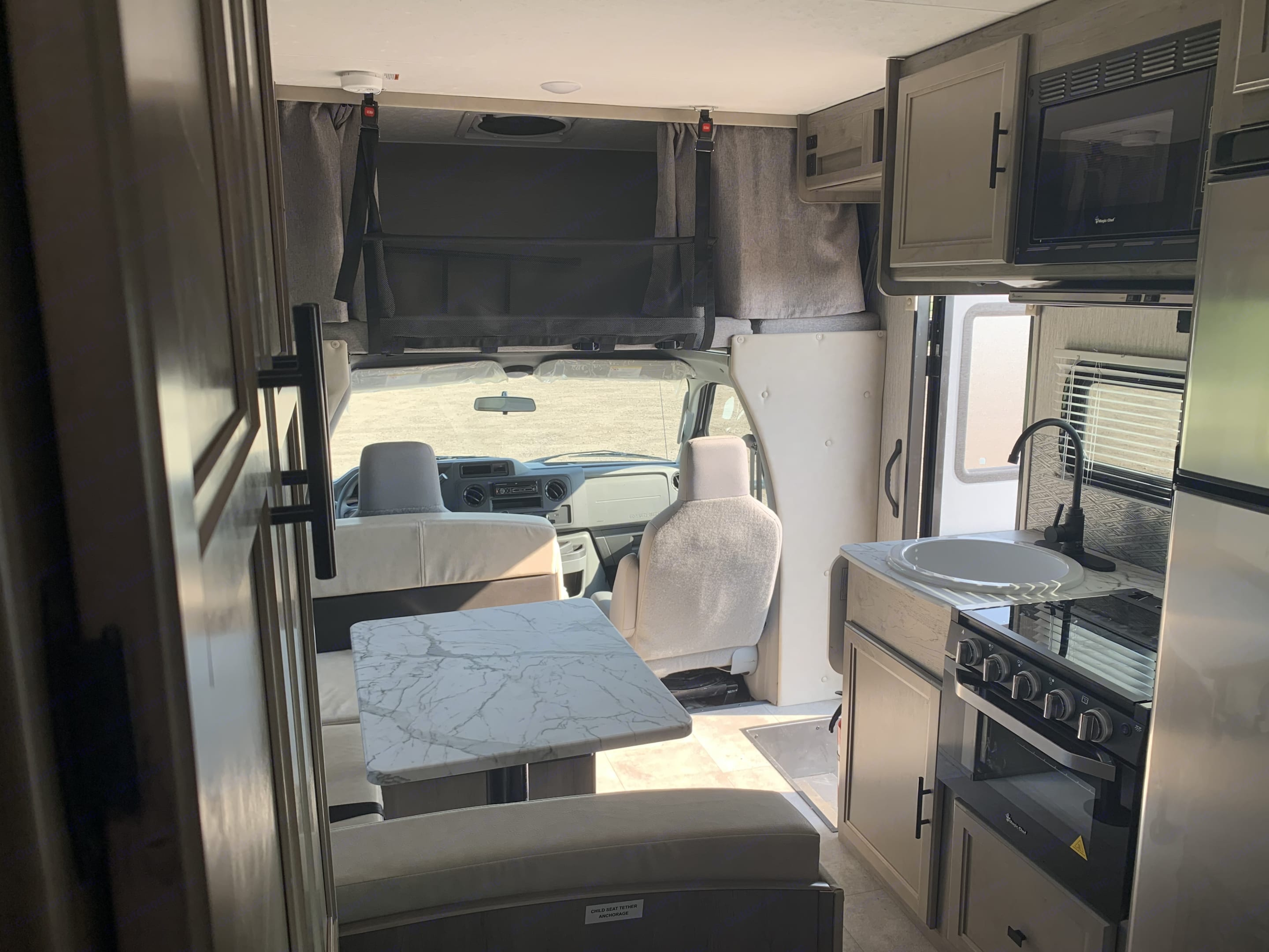 3 burner stove, large refrigerator, microwave, sink, and dinette. . Coachmen Cross Trail 2021