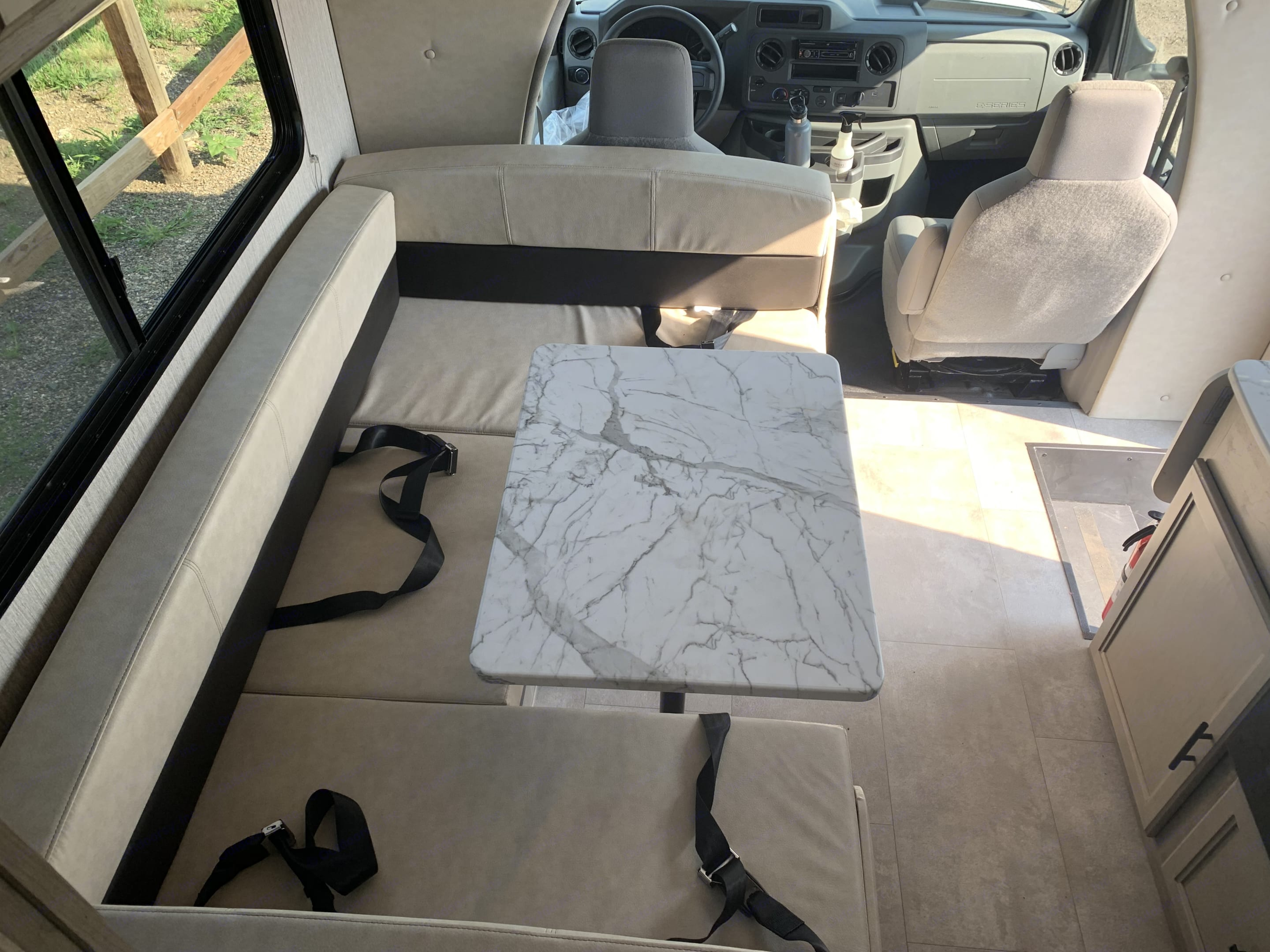Dinette includes storage under seats, 4 seatbelts, and converts into a bed. . Coachmen Cross Trail 2021