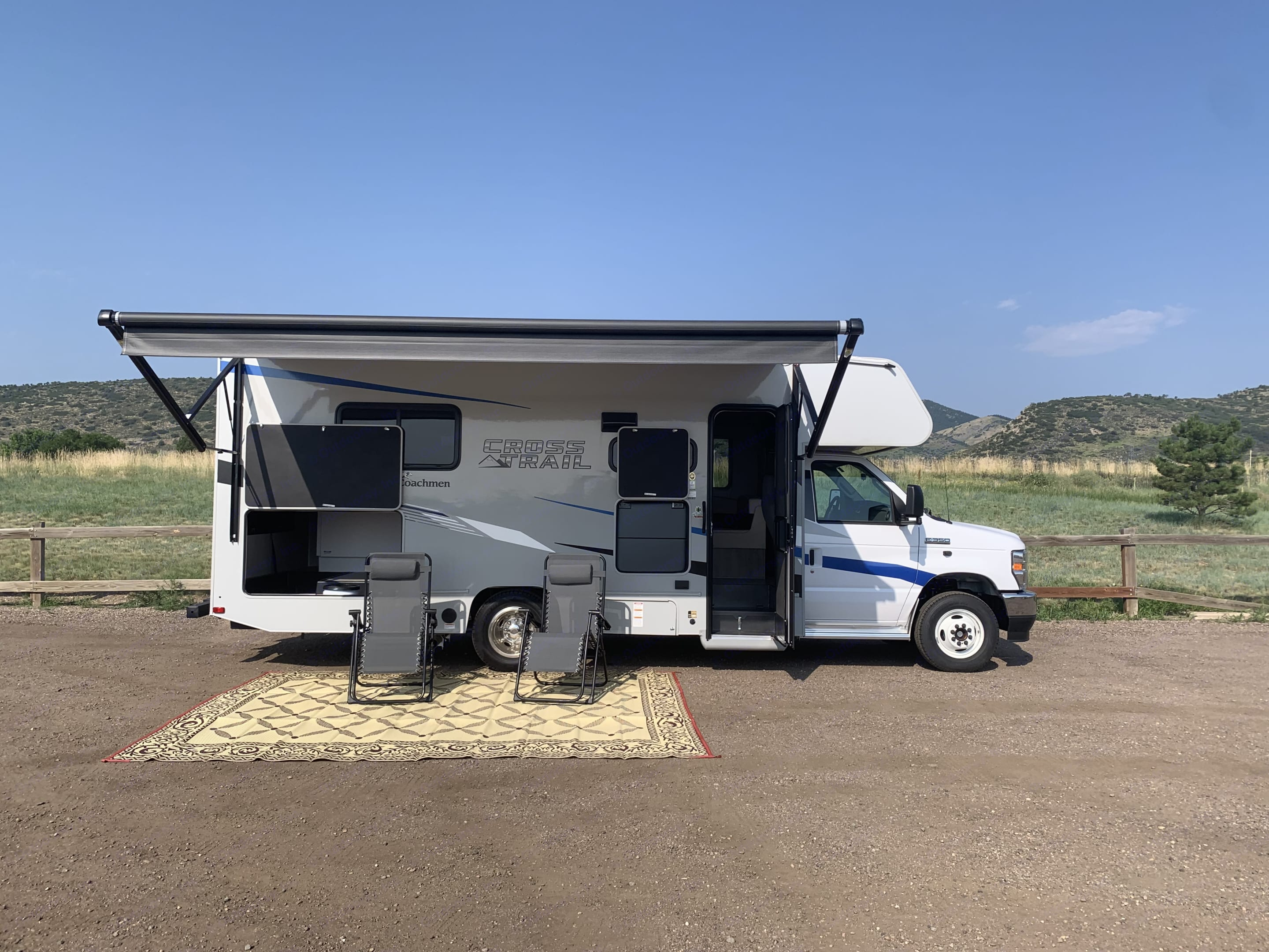 Powered awning allows you to take a break from the sun. Outdoor rug is included with rental. . Coachmen Cross Trail 2021