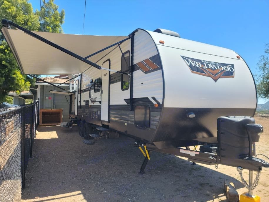 36 ft. trailer with 2 doors, outdoor kitchen, speakers play inside/outside or both.  Awning with lighting, outdoor wash station.  . Forest River Wildwood 2021