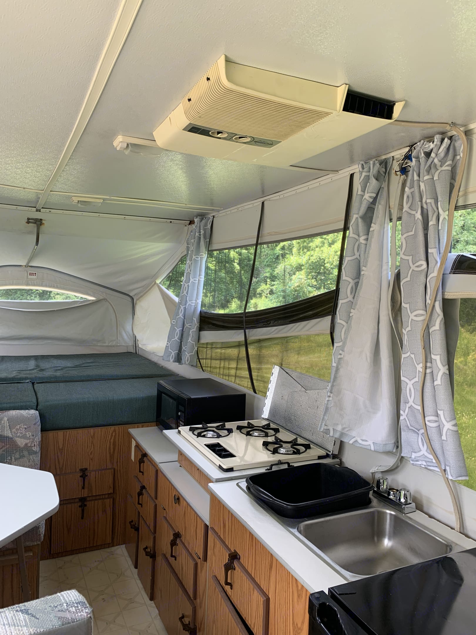 Camper has a refrigerator, microwave, and heat/Air conditioning.  . Jayco Jay Series 1993