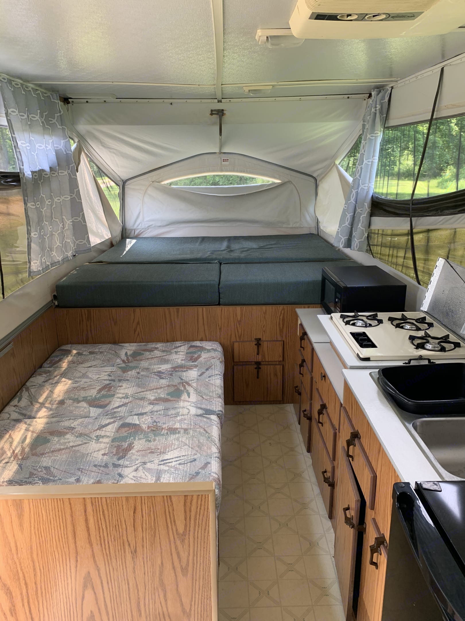 Camper can sleep 6 with the dinette down which is in this picture along with the stove inside.. Jayco Jay Series 1993