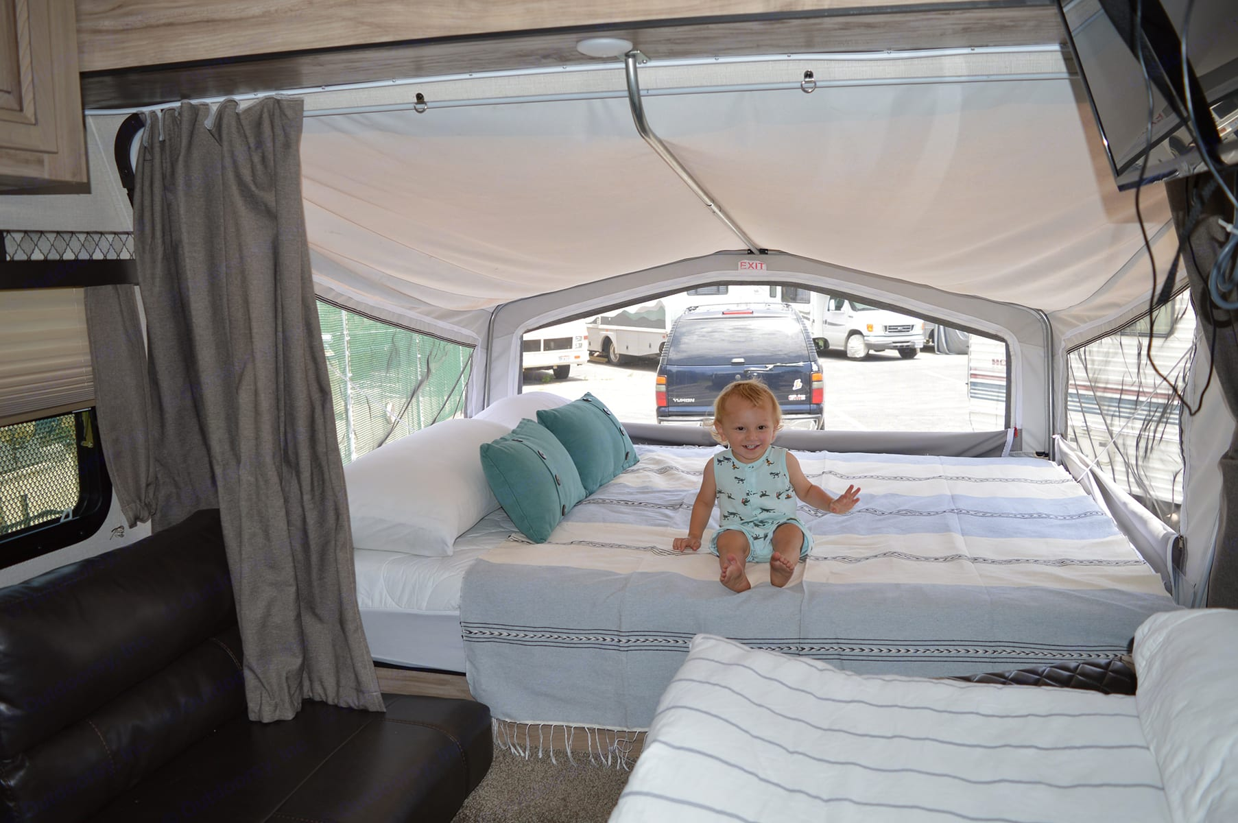 Queen bed at front of RV. Palomino Solaire Expandable 2020