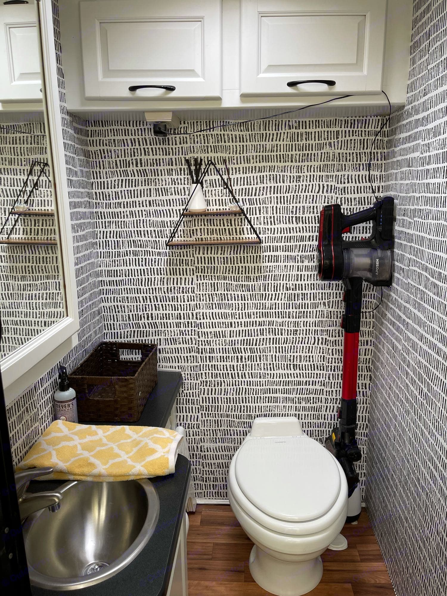 I love the wallpaper we put in here to make the royal throne that much more lovely. The vacuum charges in here for space. And that is a full size pot.. Thor Motor Coach Four Winds Majestic 2014