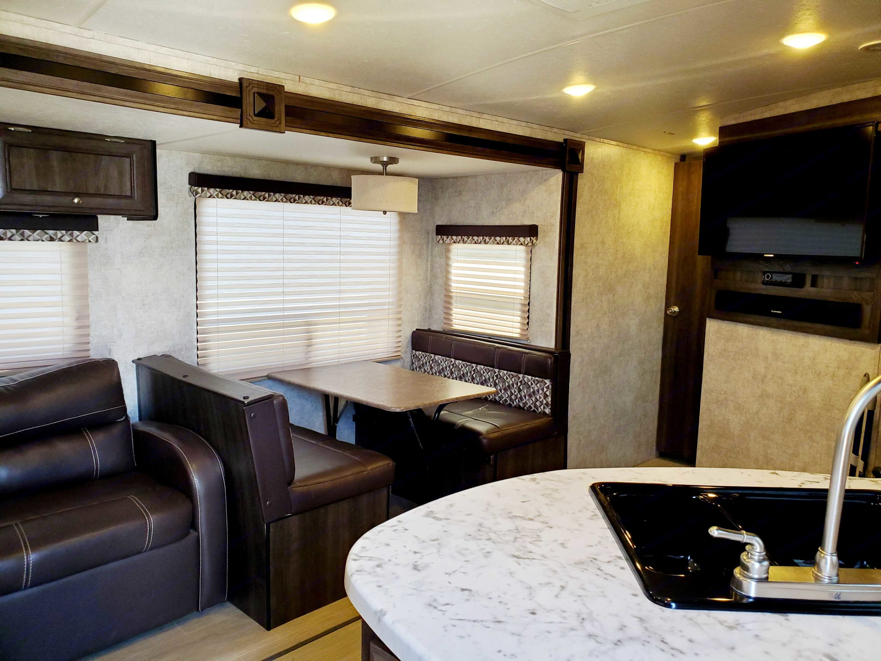The Happy Glamper has a dinning area that is a 2 for 1. It also turns into a lovely padded bed.. Open Range Light 2016
