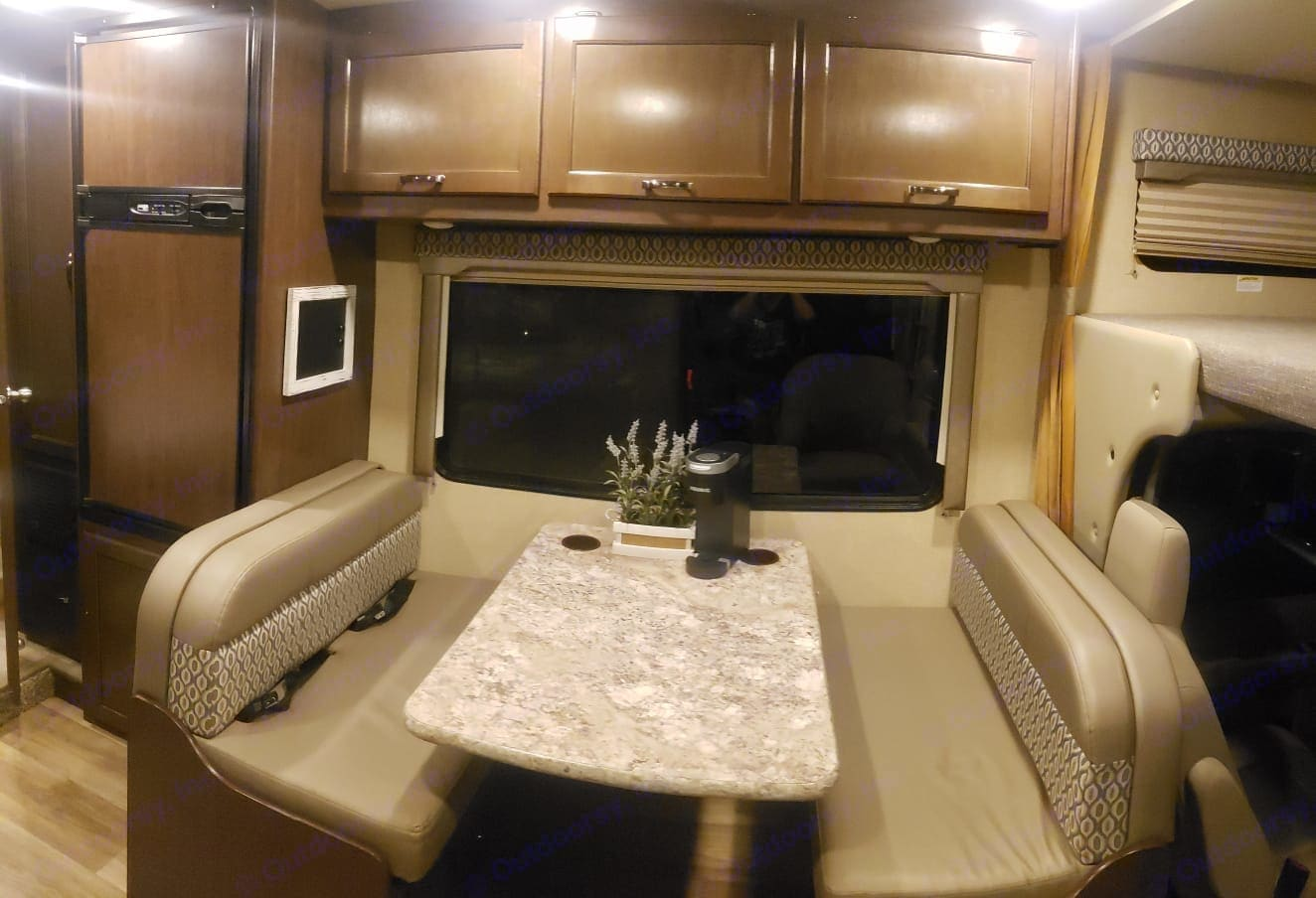 To the left is the Freezer/Refrigerator. Dinette converts into a sleeping area that can accommodate up to  two people. Two seat belts on left booth.. Thor Motor Coach Freedom Elite 2017