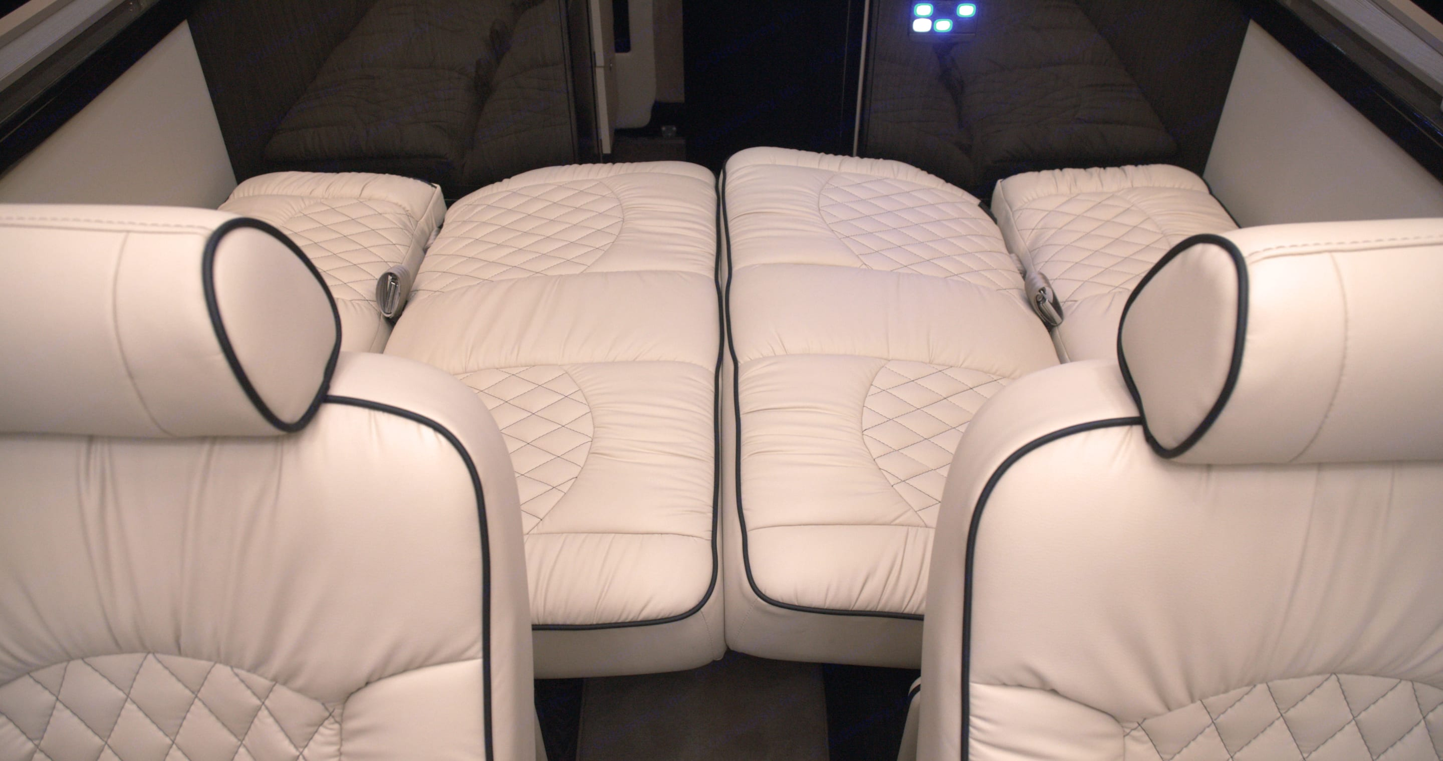 Convert the last row bench seating (4 seat belts included) into a bed that comfortably sleeps 2 adults.. Ultimate Toys Traveler 2022