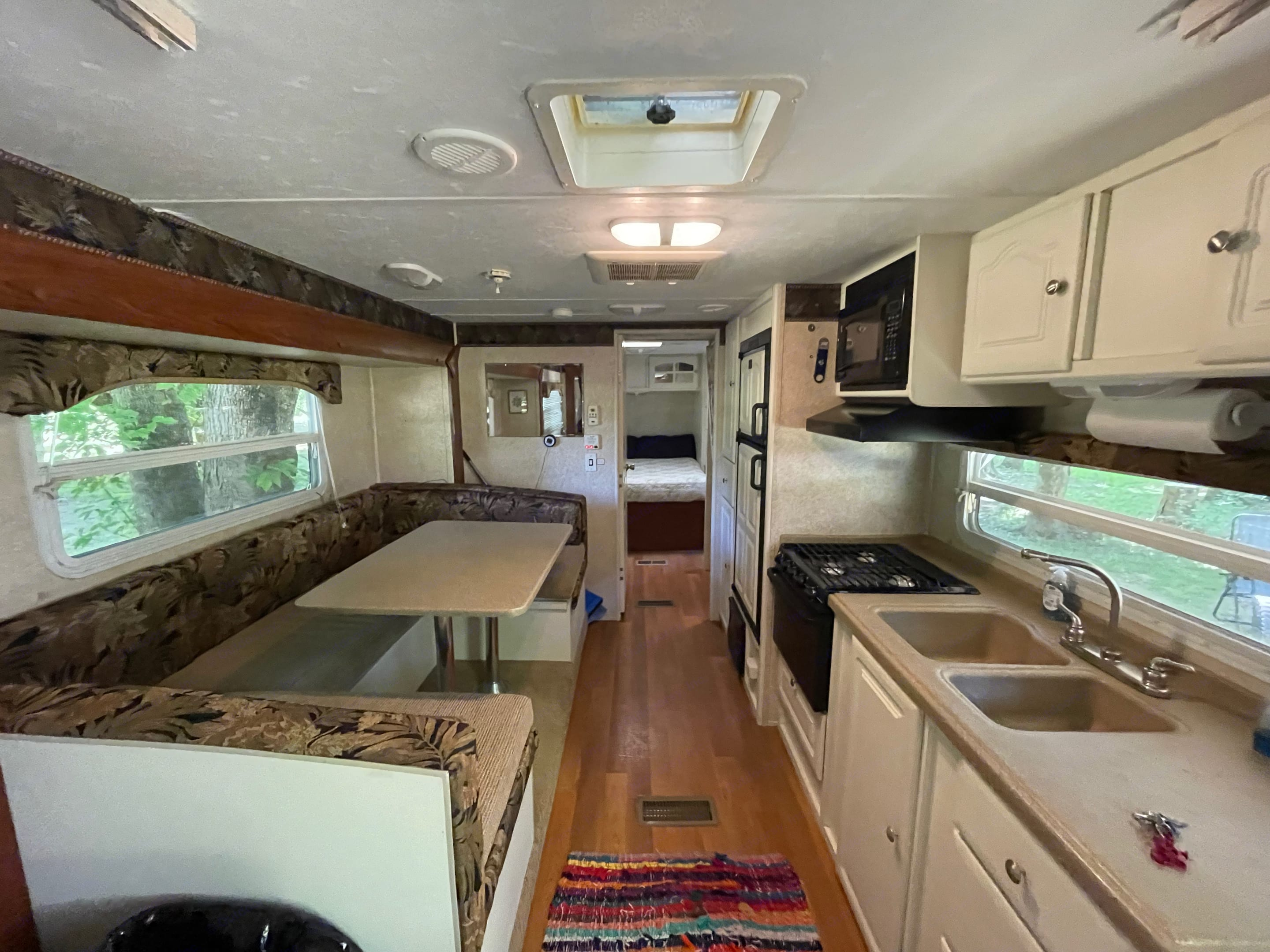 Fully Stocked Kitchen and convertible sleeper dinette. Cook great meals and room for a crowd!. Keystone Outback 2007